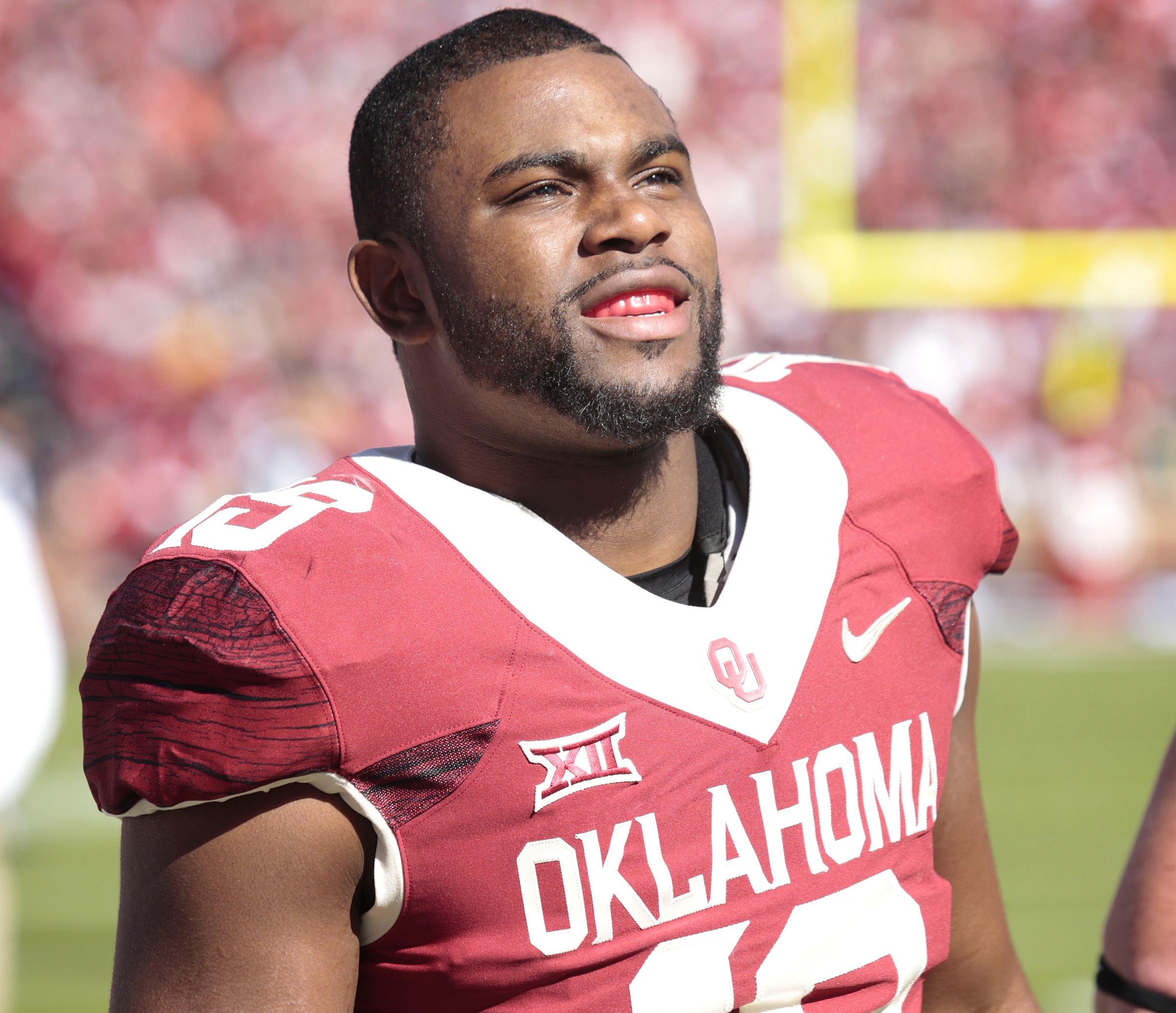 NORMAN, OK - NOVEMBER 8:  Linebacker Eric Striker #19 of the Oklahoma Sooners watches the scoreboard before the game against the Baylor Bears November 8, 2014 at Gaylord Family-Oklahoma Memorial Stadium in Norman, Oklahoma. Baylor defeated Oklahoma 48-14.  (Photo by Brett Deering/Getty Images)