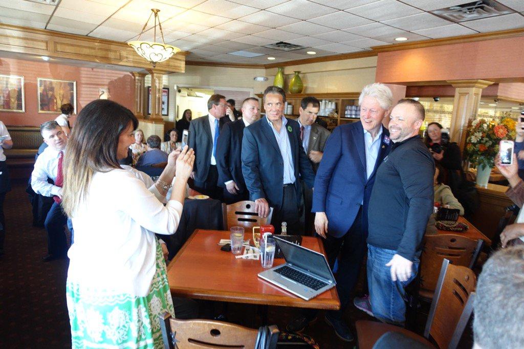 Former President Bill Clinton visits with patrons at Alton's restaurant in Cheektowaga early Monday afternoon. (John Hickey/Buffalo News)