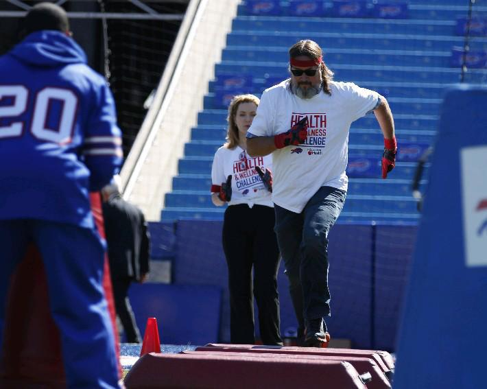 Chris 'The Bulldog' Parker helped introduce the Independent Health Buffalo Bills Health & Wellness challenge in 2014. Participants in the latest challenge this spring will be eligible to participate in boot camp classes on the Ralph Wilson Stadium field. (Sharon Cantillon/Buffalo News file photo)
