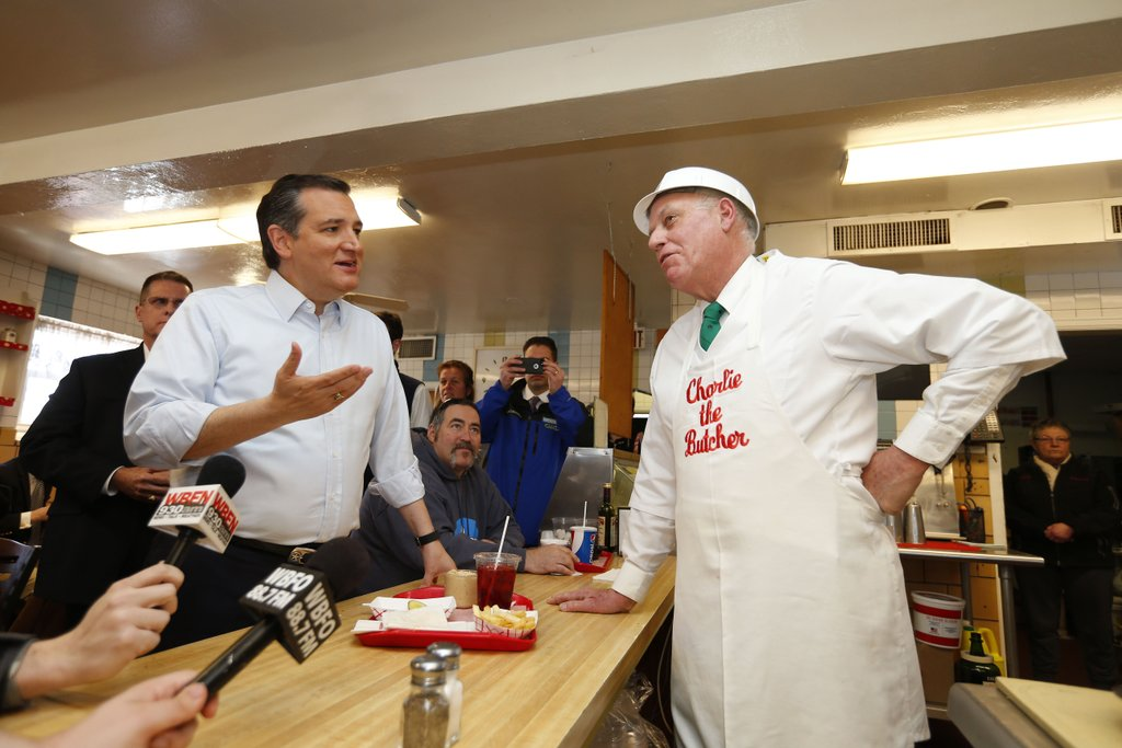 Sen. Ted Cruz tries beef on weck as he talks with Charlier the Butcher owner Charlie Roesch on Thursday. (Mark Mulville/ Buffalo News)