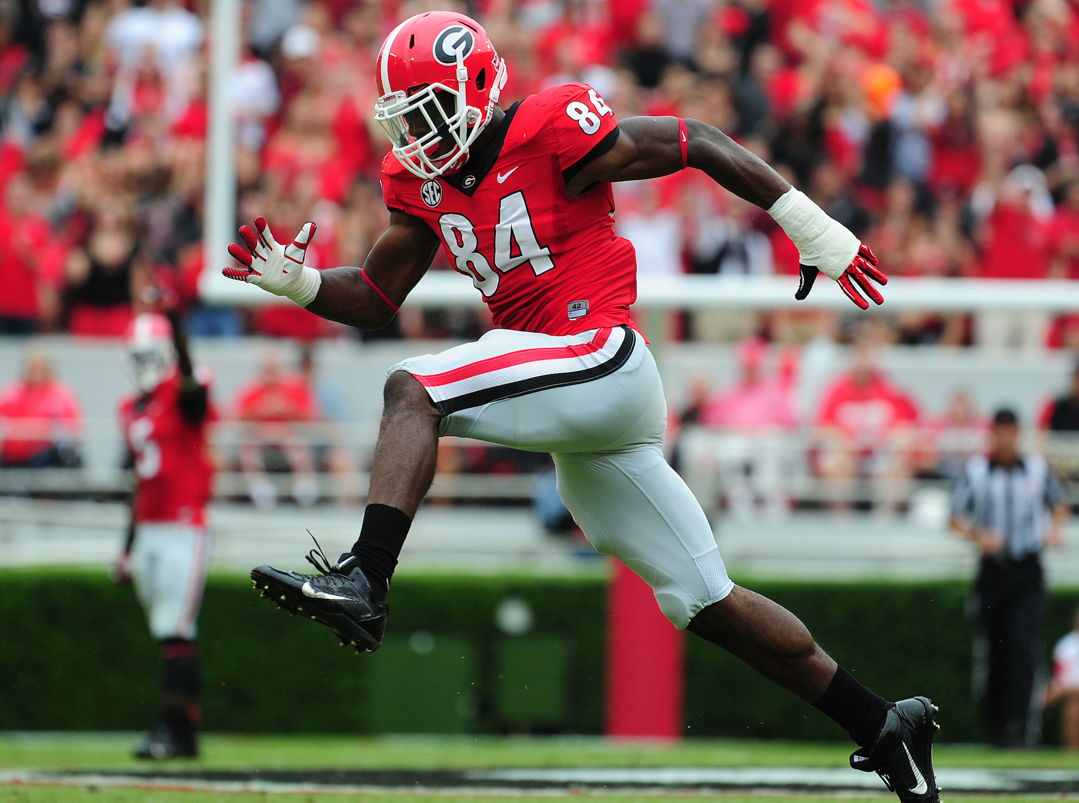 ATHENS, GA - SEPTEMBER 21: Leonard Floyd #84 of the Georgia Bulldogs celebrates after making a tackle against the North Texas Mean Green at Sanford Stadium on September 21, 2013 in Athens, Georgia. (Photo by Scott Cunningham/Getty Images) *** Local Caption *** Leonard Floyd