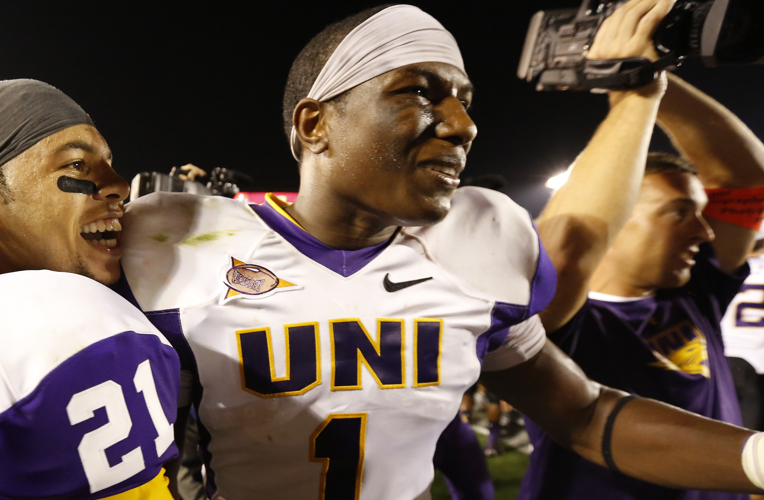 AMES, IA - AUGUST 31:  Wide receiver Phil Wright #21 of the Northern Iowa Panthers celebrates with teammate defensive back Deiondre' Hall #1 after defeating the Iowa State Cyclones 28-20 at Jack Trice Stadium on August 31, 2013 in Ames, Iowa. (Photo by David K Purdy/Getty Images)