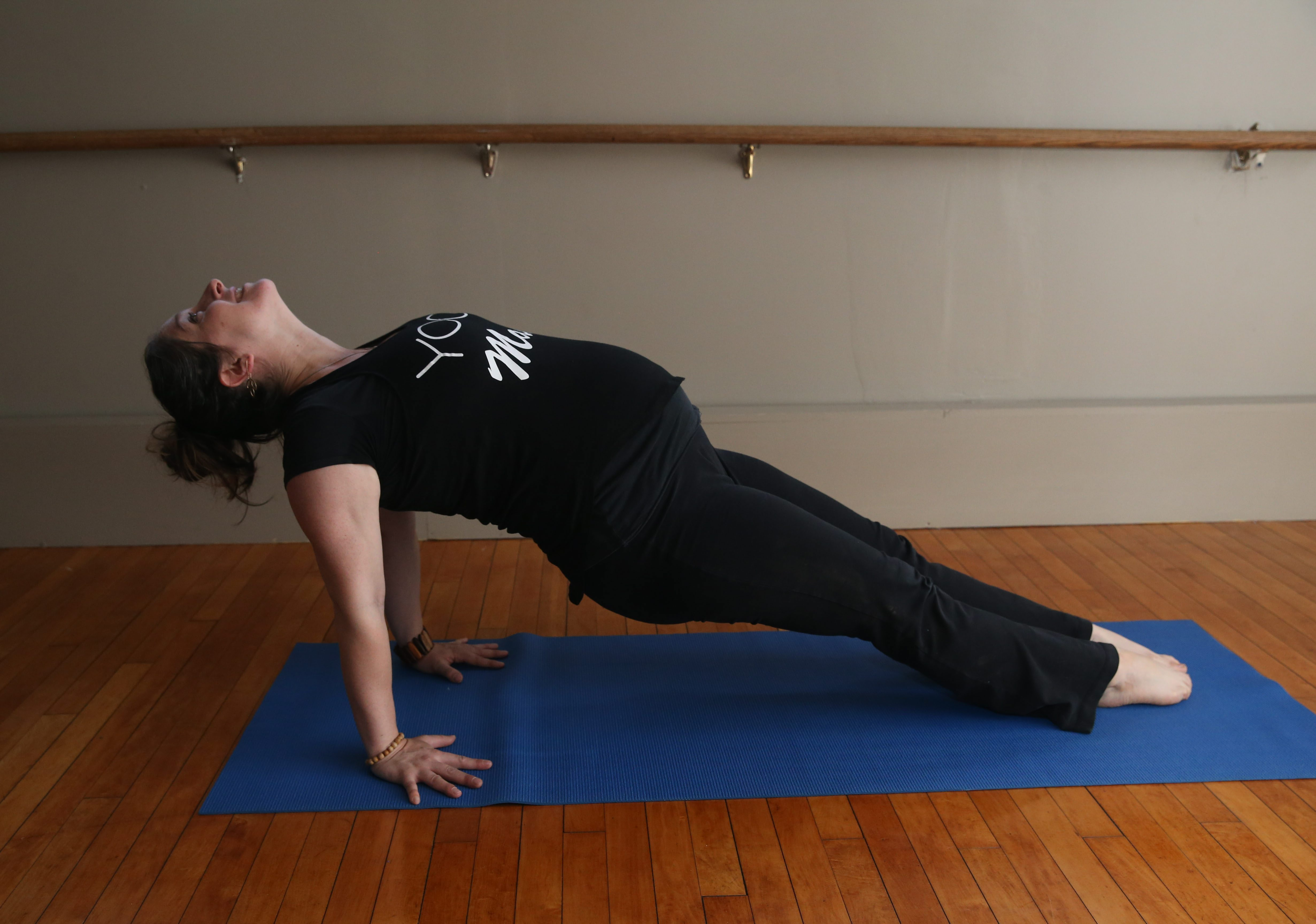 Megan Callahan, who is 34 weeks pregnant, still teaches many yoga classes each week.  She is the owner of Yoga Parkside.  (Sharon Cantillon/Buffalo News)