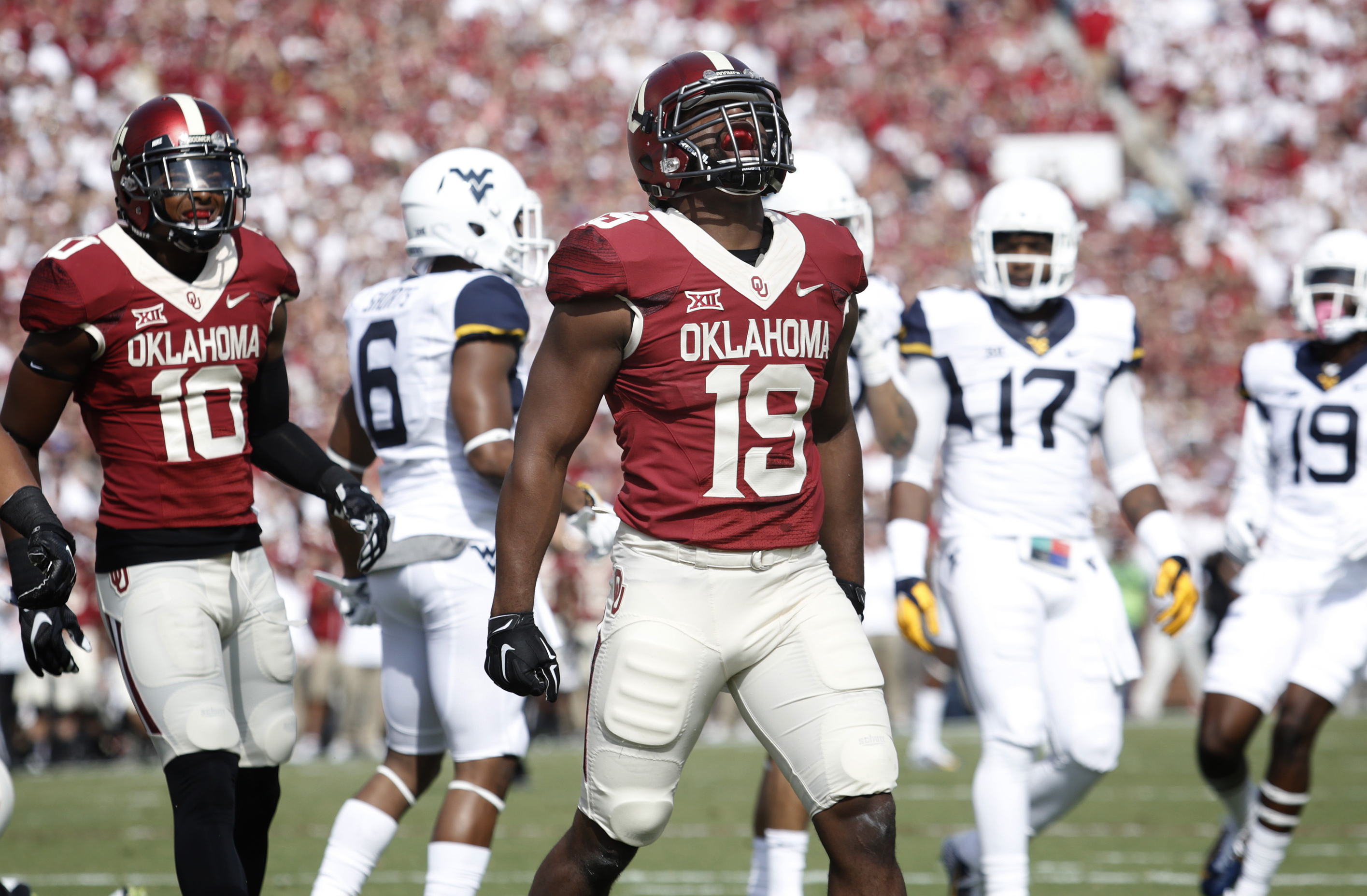 NORMAN, OK - OCTOBER 3:  Linebacker Eric Striker #19 of the Oklahoma Sooners celebrates a quarterback sack against the West Virginia Mountaineers October 3, 2015 at Gaylord Family-Oklahoma Memorial Stadium in Norman, Oklahoma. Oklahoma defeated West Virginia 44-24.(Photo by Brett Deering/Getty Images)