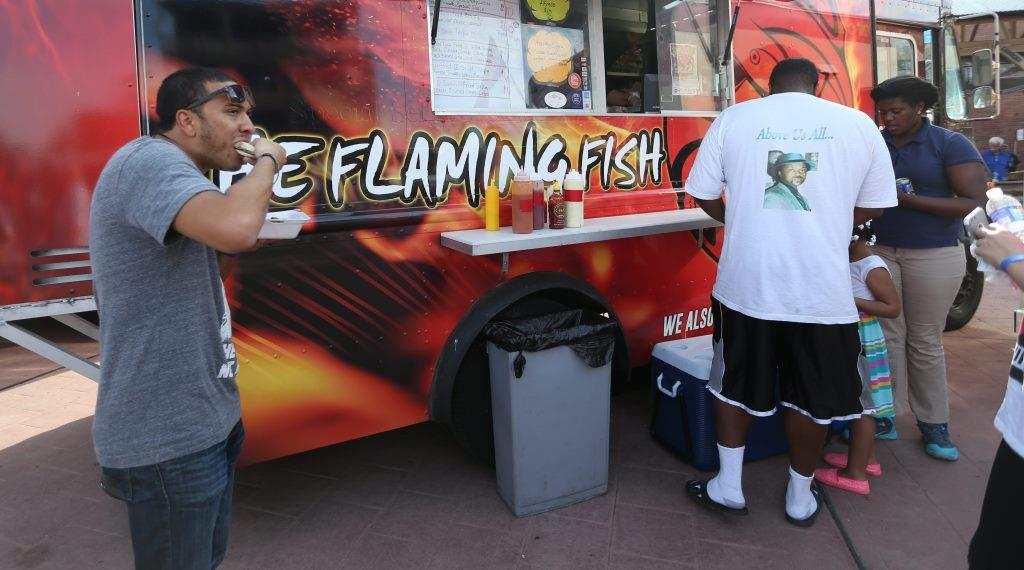 There was a great turn out for Food Truck Tuesday, Tuesday, May 26, 2015 at Larkinville. Folks came out to enjoy beautiful weather, tasty food and good music. This is The Flaming Fish food truck. (Sharon Cantillon/Buffalo News file photo)