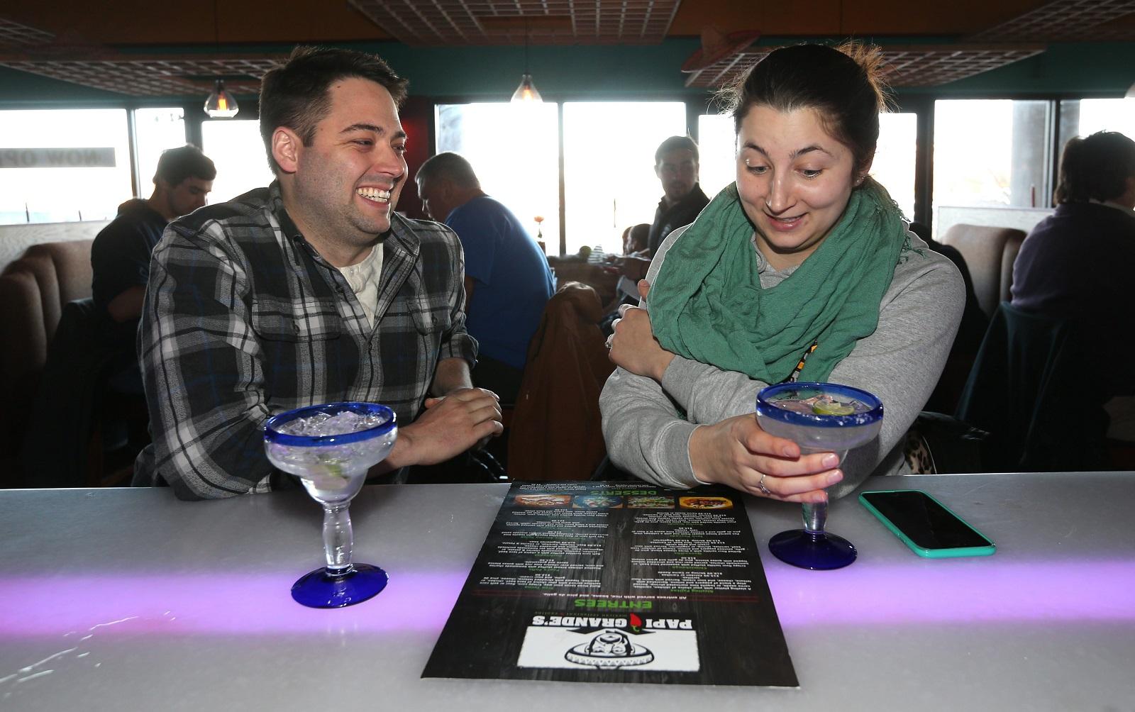 Josh Keller, left, and Jamie Szymanski of the Town of Tonawanda, enjoy a couple of margaritas. (Sharon Cantillon/Buffalo News)