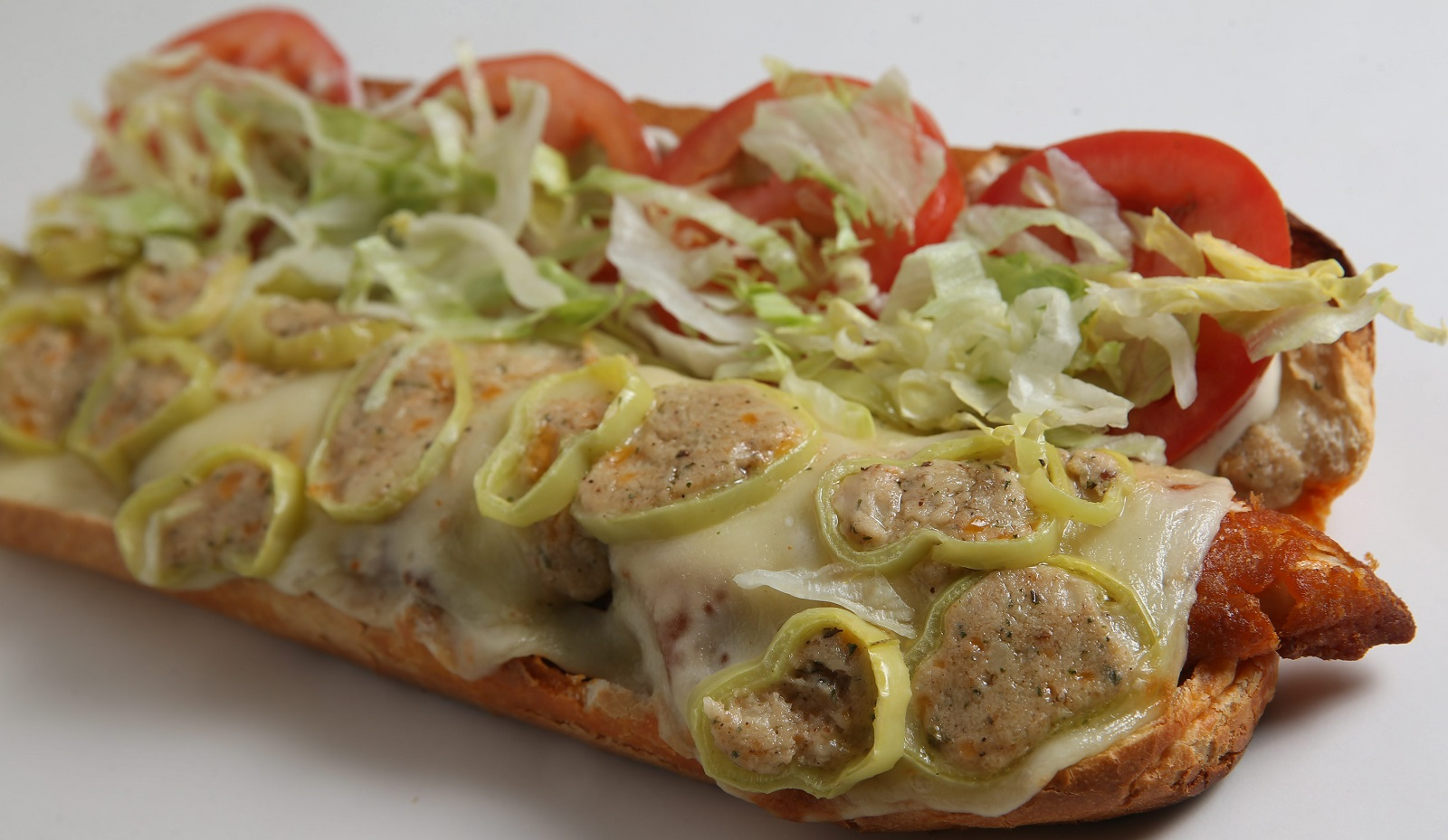 The Lovejoy Street chicken finger sub with sliced stuffed peppers, mozzarella, tomato, lettuce, onion with mayo or blue cheese dressing from Lovejoy Pizza. (Sharon Cantillon/Buffalo News)