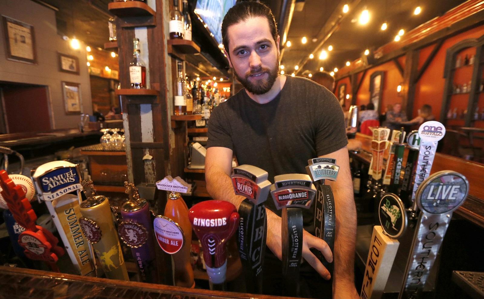 Manager and bartender Matt Santarsiero works one end at Local Kitchen & Beer Bar. (Robert Kirkham/Buffalo News)