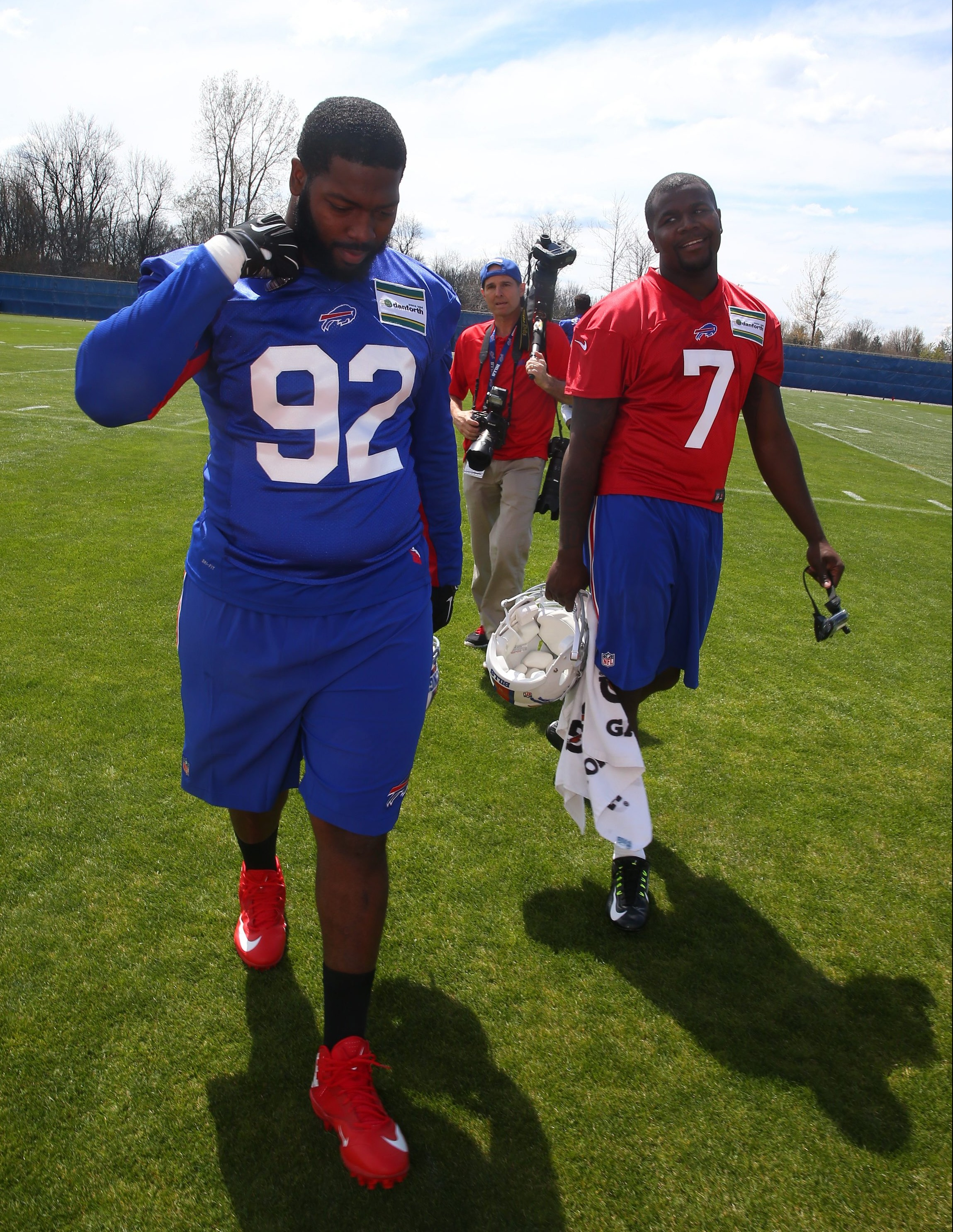 Buffalo Bills players -- and former Ohio State teammates -- Adolphus Washington (92) and Cardale Jones (7) walk off the practice field. (John Hickey/Buffalo News)