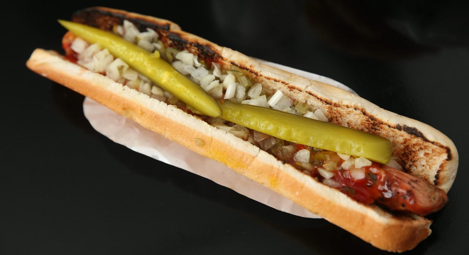 Louie's Hot Dogs' foot-long has mustard, ketchup, relish, onions and pickles. (Sharon Cantillon/Buffalo News)