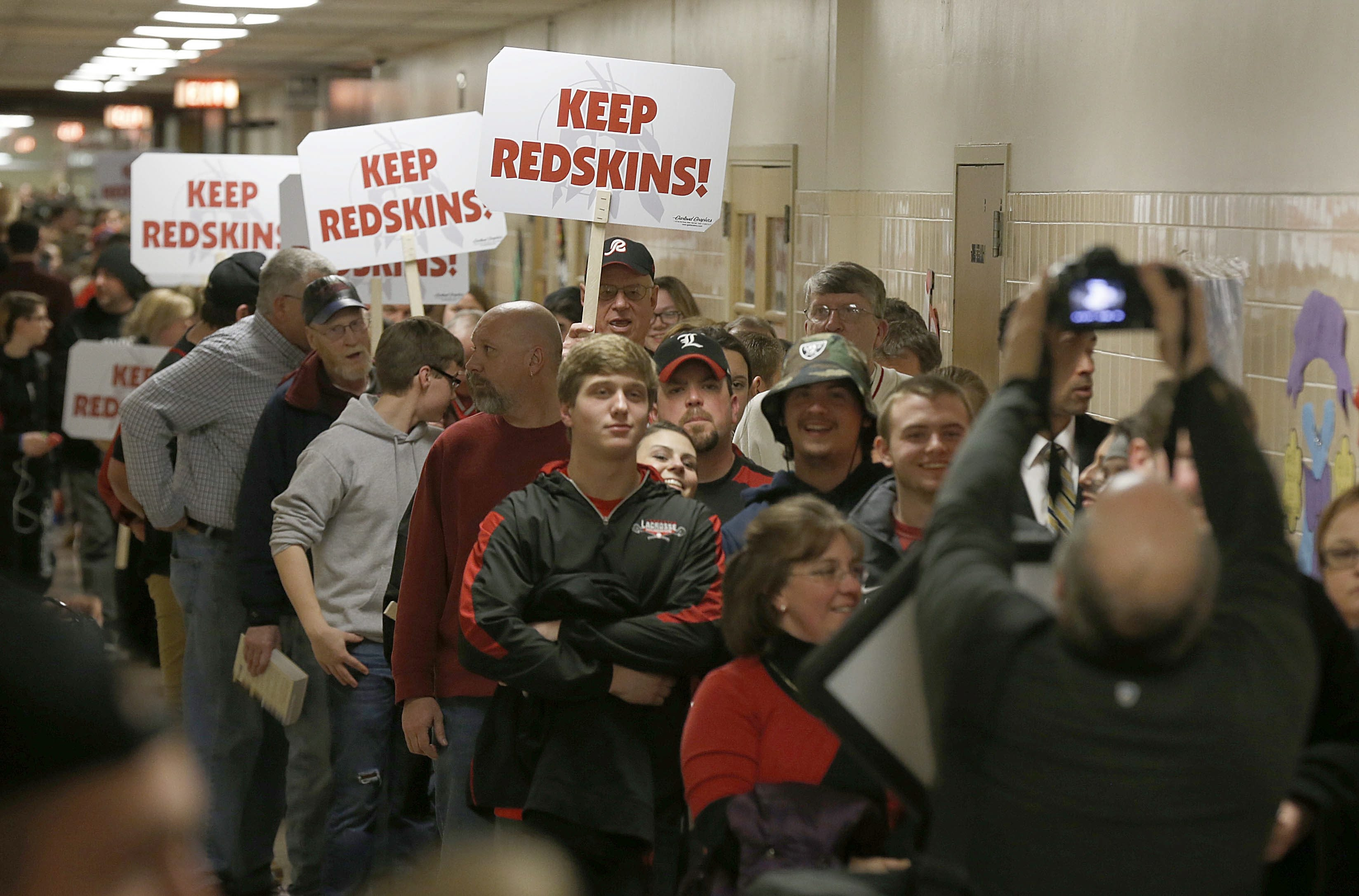 """A large crowd in support of keeping the """"Redskin"""" mascot name and those opposed line the entire hallway of Lancaster High School waiting for admittance into the community engagement session in the school's cafeteria on Tuesday, March 3, 2015. (Robert Kirkham/Buffalo News)"""