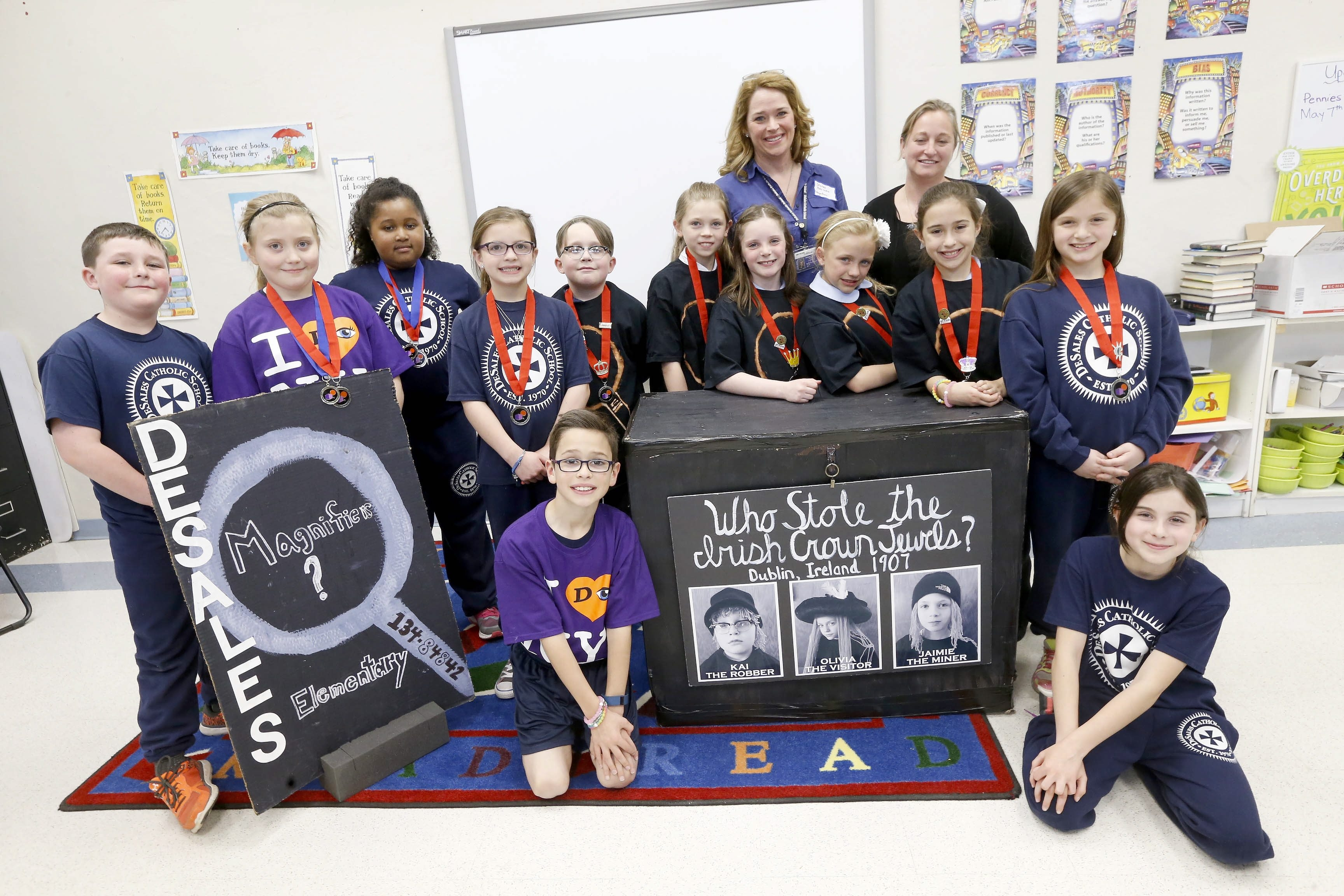 """DeSales Catholic School students and teachers heading to """"Destination Imagination in Knoxville, Tenn., later this month include:"""" kneeling, from left, Dominic Pellicano and Isabella Watson; standing, from left, Daniel Rahill, Aubree Parker, Hannah Upshaw, Jillian Knuutila, Kai Schiesel, Jaimie Fraass, Sydney Mosher, Olivia Rongo, Natalie Pellicano and Sophia Goyette; teachers in back row, from left, Stacey Pellicano and Nicole Goyette."""