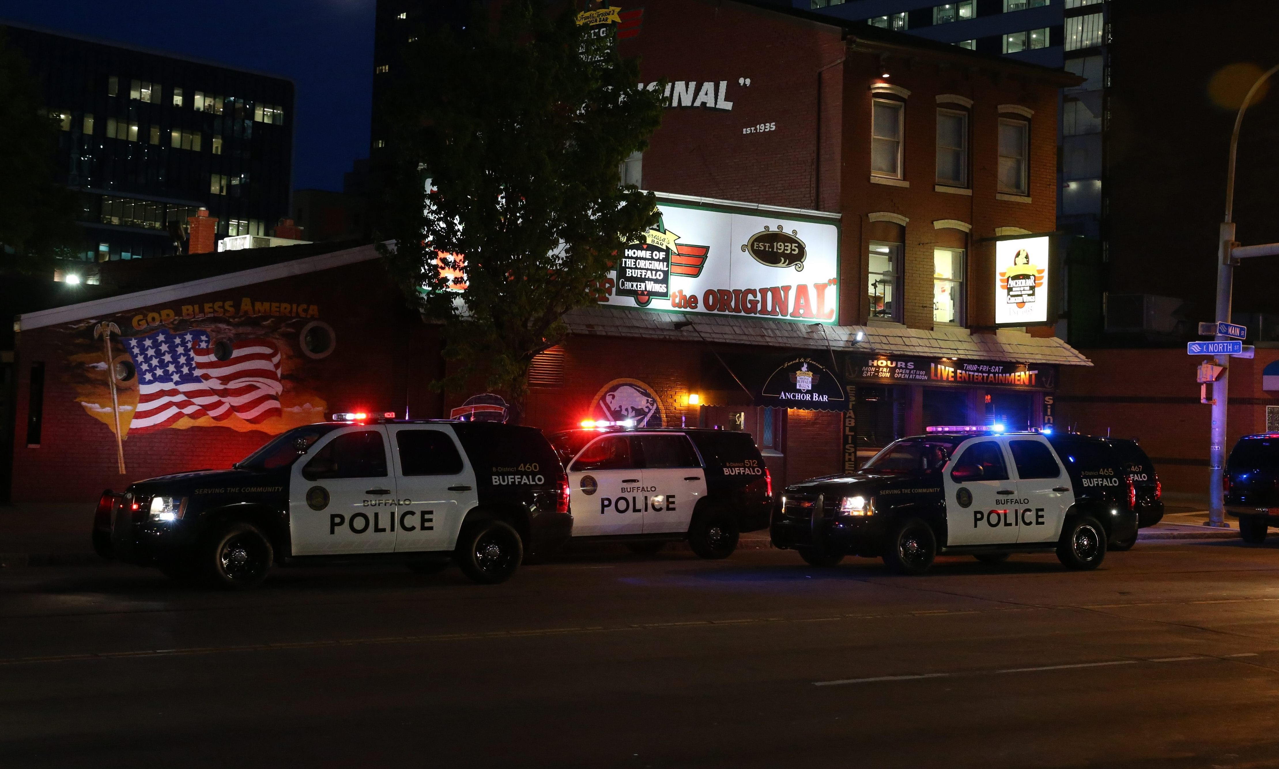 Police were on the scene Friday night after a shooting took place inside the Anchor Bar. (James P. McCoy/ Buffalo News)