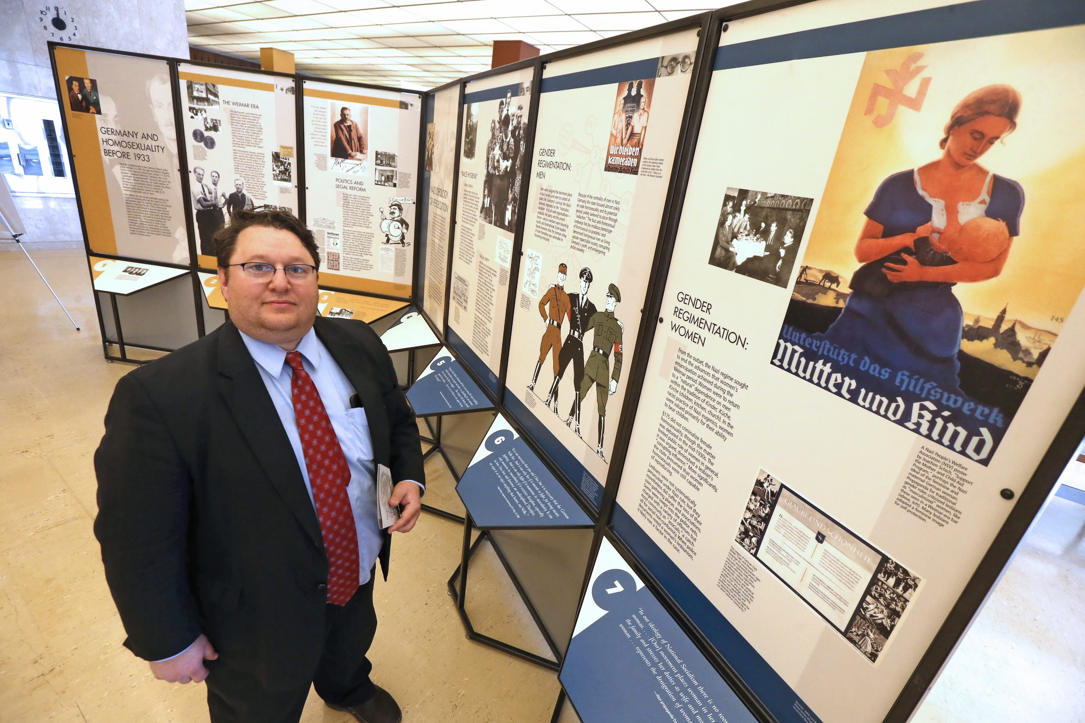 """Pieter(cq) Weinrieb, co-pres. of local Holocaust Resource Center, explores the new exhibit, """"Nazi Persecution of Homosexuals 1933-1945,"""" which opened last Sunday and is on-loan from the Holocaust Museum in the """"Whisper Space"""" section of the main central public library in downtown Buffalo on Wednesday, May 25, 2016.  ()"""