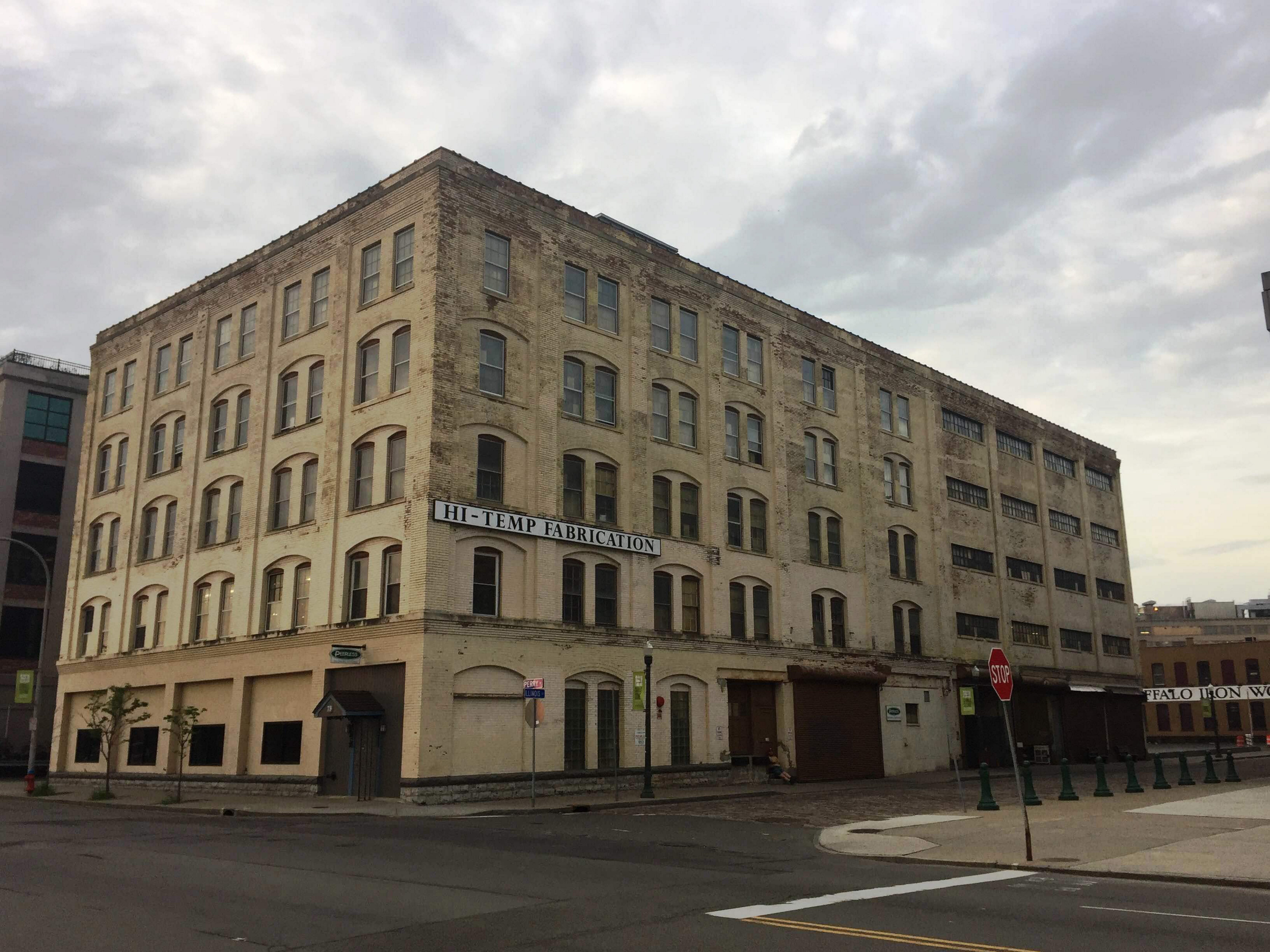 The century-old building at 79 Perry St. was constructed in 1914 for Peerless Mill Supply Co., which still operates there as Peerless Inc. It shares the building with Hi-Temp. Both are expected to move following the building sale. (Aaron Besecker/Buffalo News)