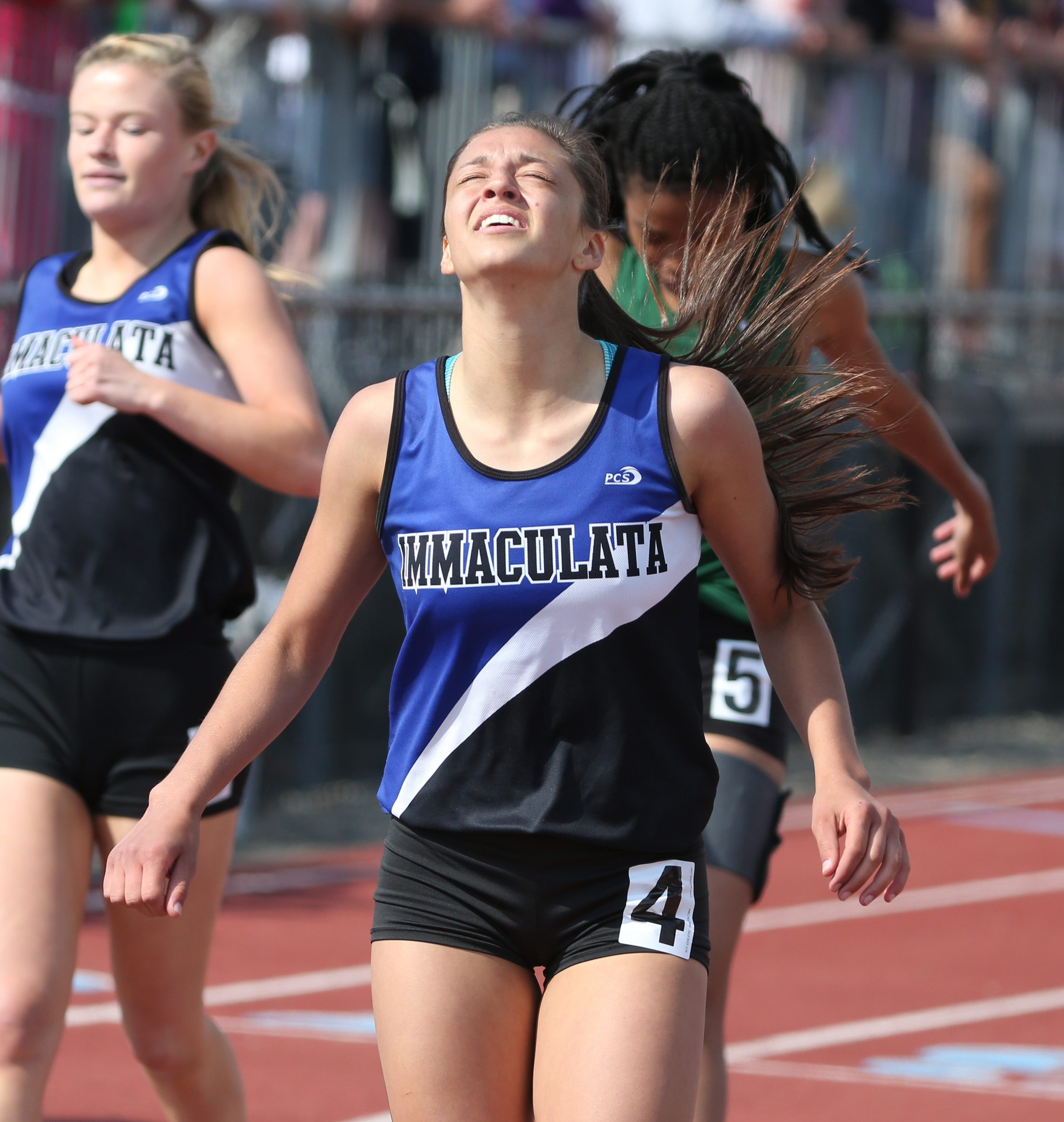 Immaculata's Emilee Chiavetta wins the 200m during the All-Catholic track at St. Francis High School  in Buffalo, NY on Sunday,May 22, 2016.  (James P. McCoy/ Buffalo News)