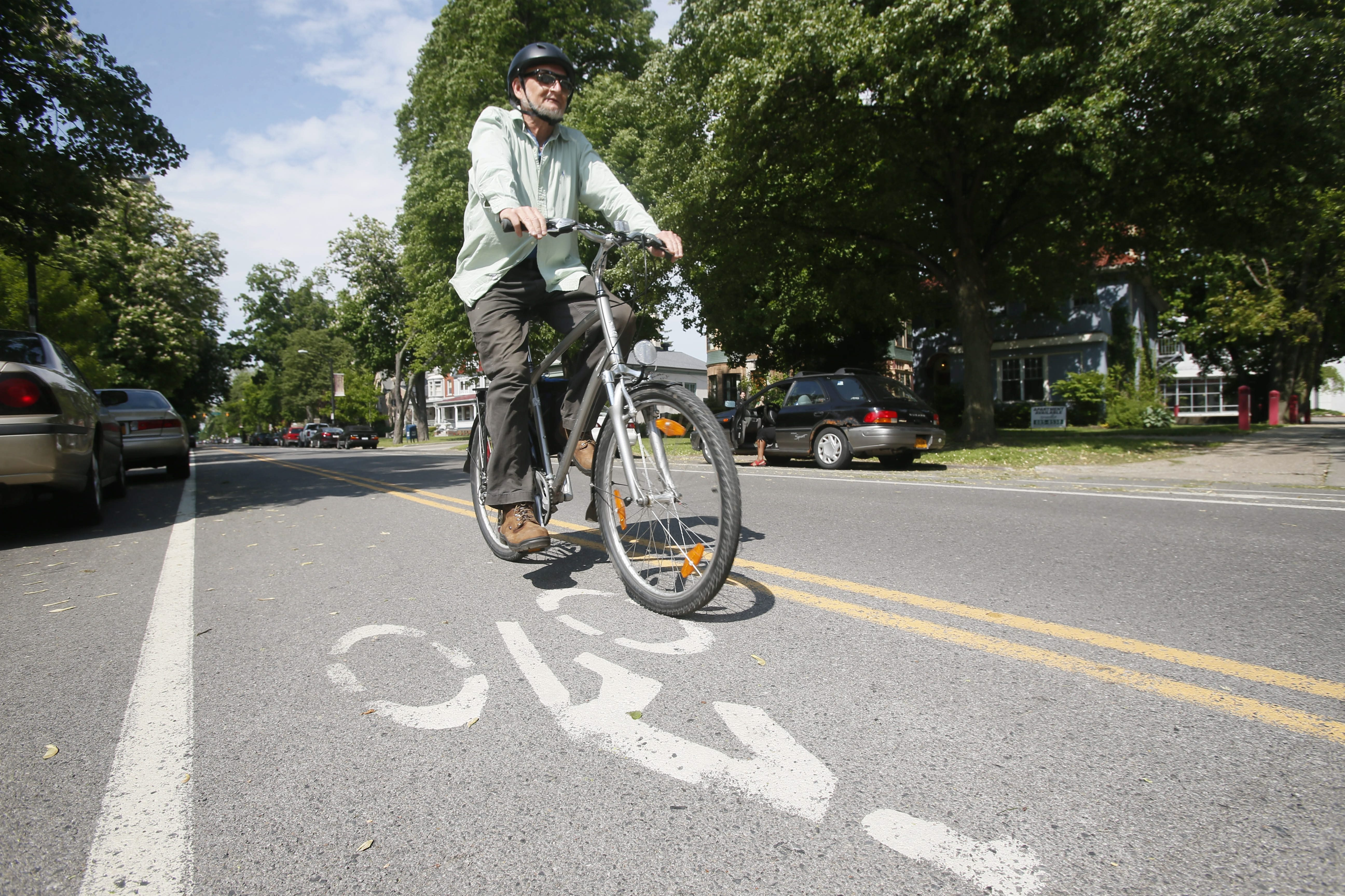 Cyclist Paul Siepierski of Buffalo rides in the bike lane on Linwood Avenue, which is one-way for automobile traffic, but features well marked bike lanes in either direction. (Derek Gee/News file photo)