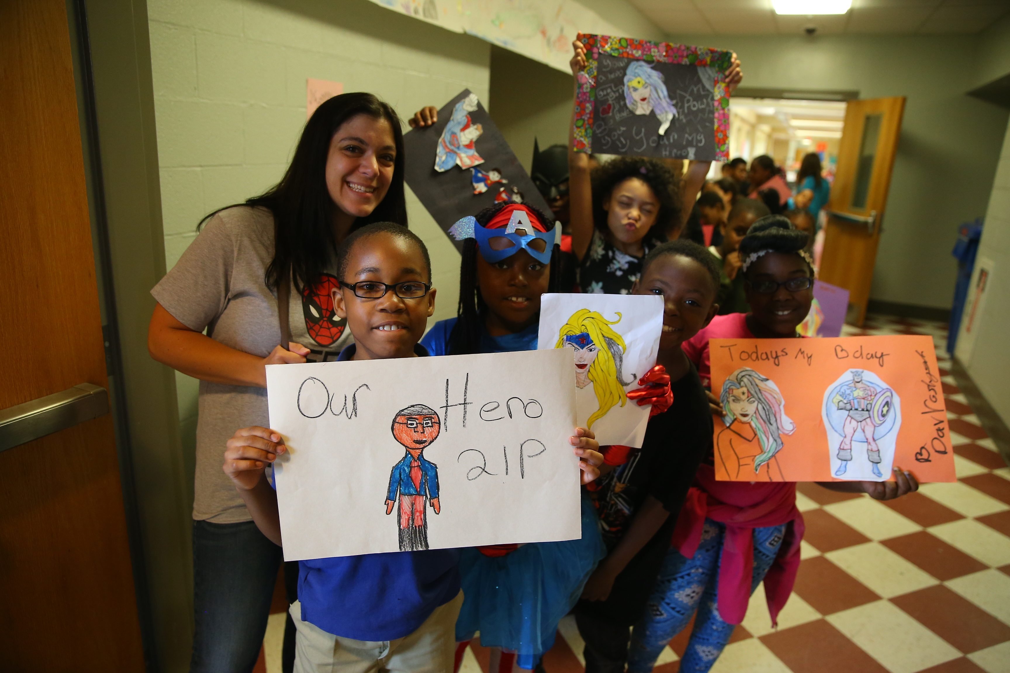 Students in Christina Hoinski's third-grade class marched with art work on Super Hero William Boatwright Day  at the Stanley M. Makowski Early Childhood Center on Friday. William A. Boatwright Jr., the school's beloved principal, died of a blood clot last month.
