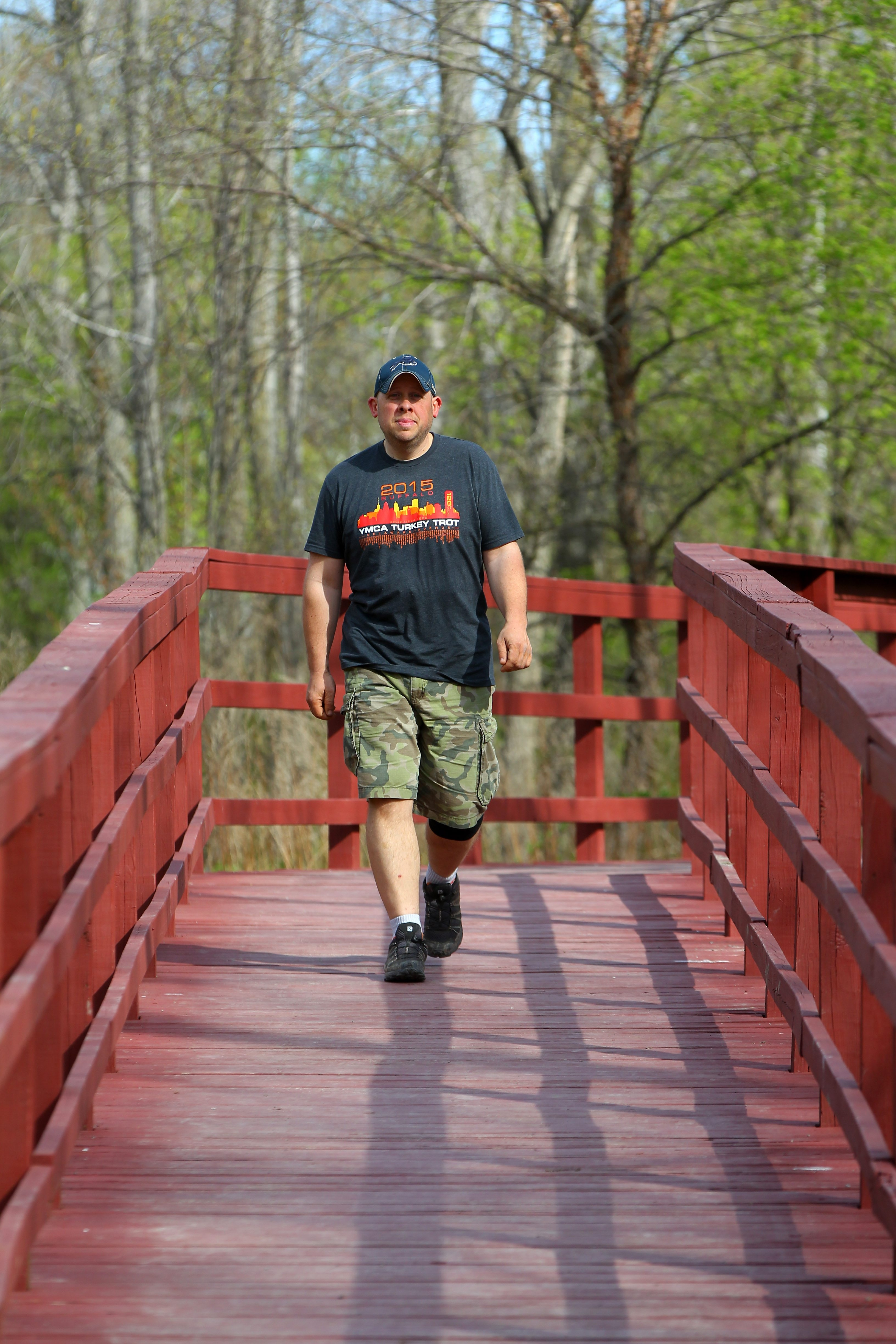 """Charles """"Chuck"""" Feldman, who lost 70 pounds after beginning a walking and hiking regimen, walks at the Charles E. Burchfield Nature and Arts Center in West Seneca on Wednesday."""