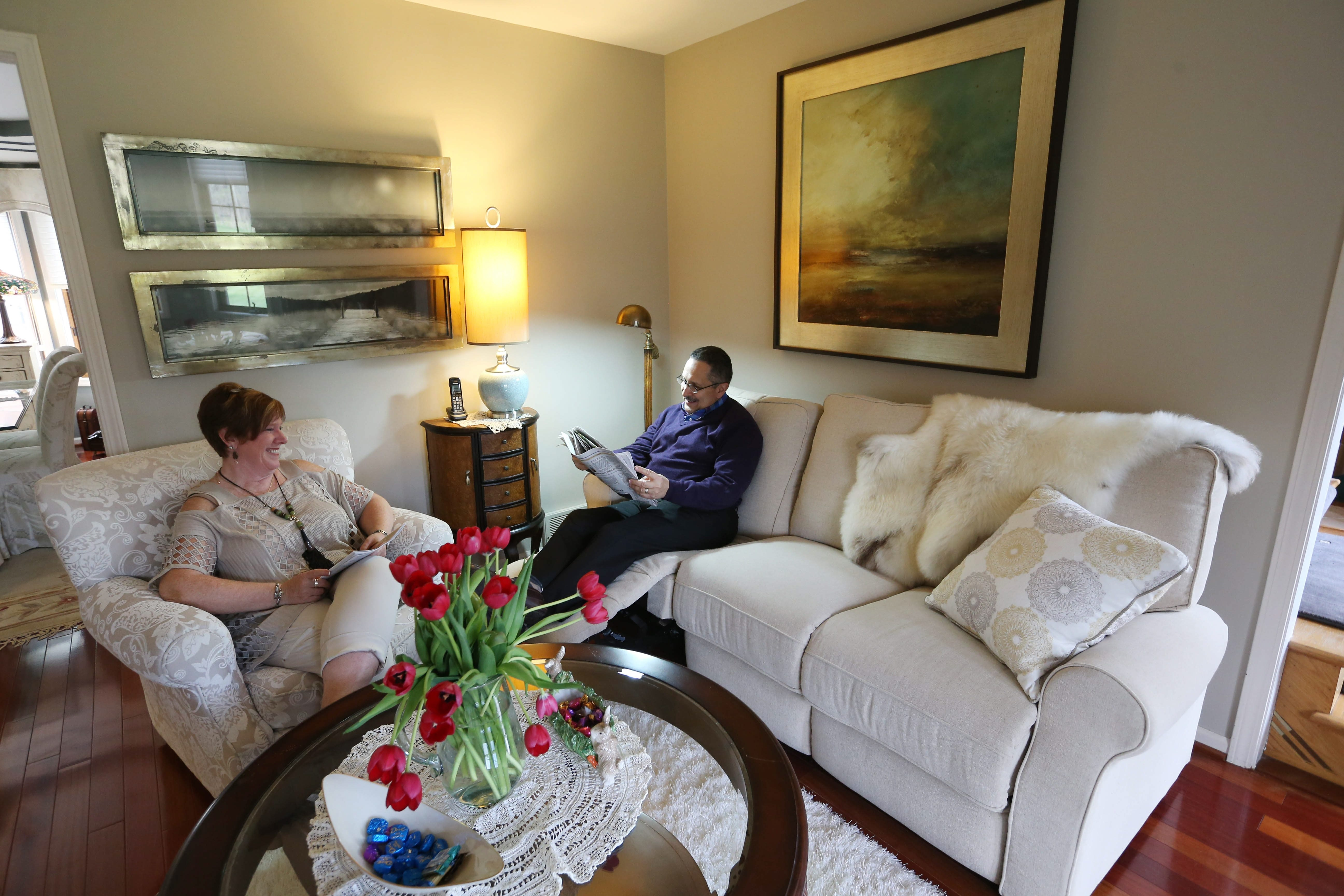 Carlos and Dana Martinez have a new favorite room since they recently remodeled their living room where they now love to read and relax. The room features comfortable furniture, a baby grand piano and a fireplace.