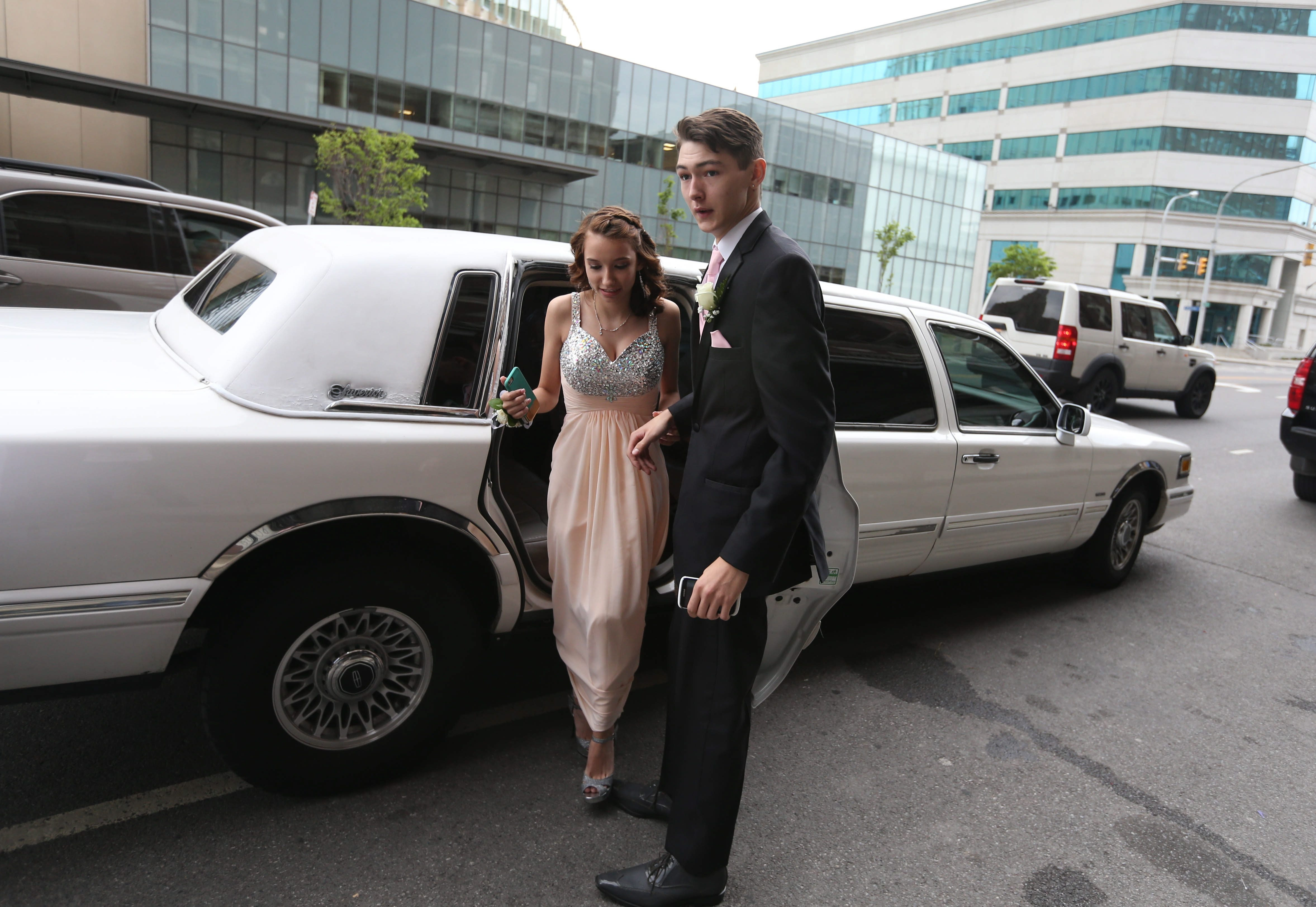 Sweet Home High School's senior prom took place at the Buffalo Statler, Thursday, June 11, 2015.  Limos pull up and drop off groups of prom-goers.  Jared Manhardt and his date Cristyn Schwab, get out of the car.  (Sharon Cantillon/Buffalo News)