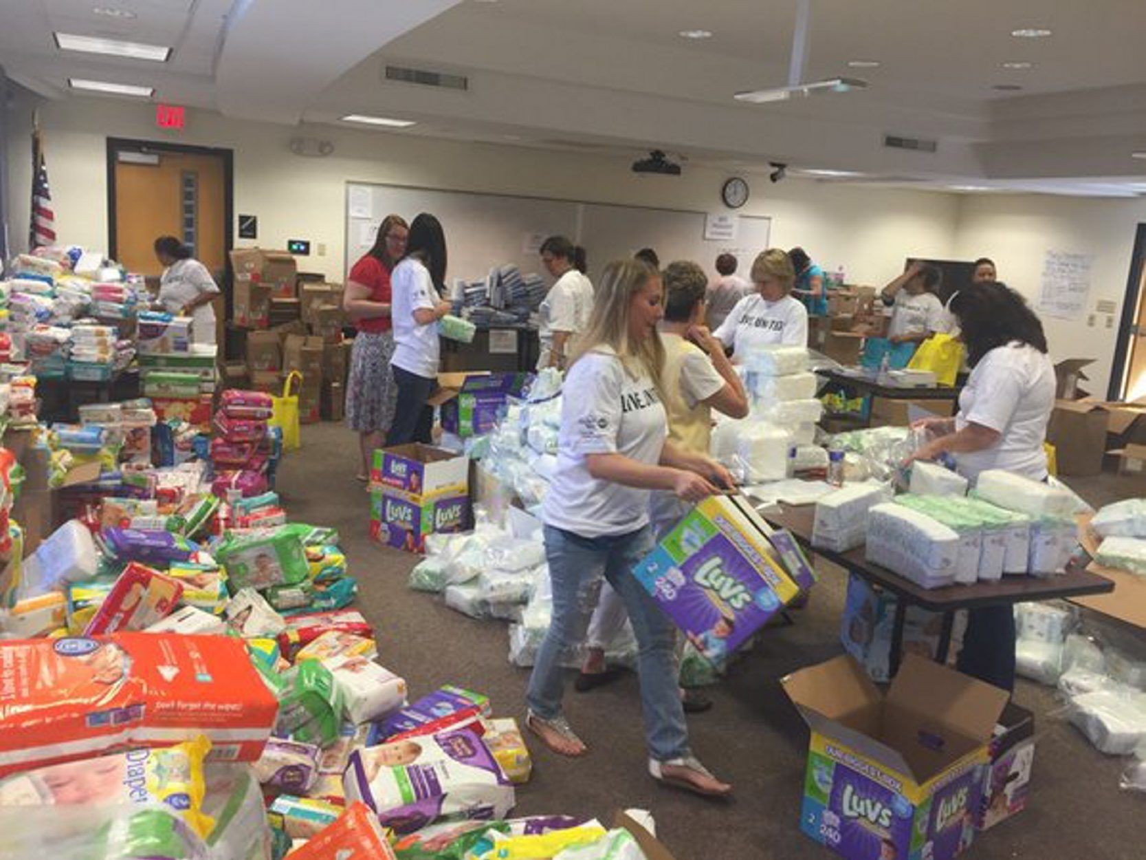 United Way of Buffalo & Erie County volunteers sort and pack items for its Community Baby Shower  for local at-risk moms and babies. (John Hickey/Buffalo News)