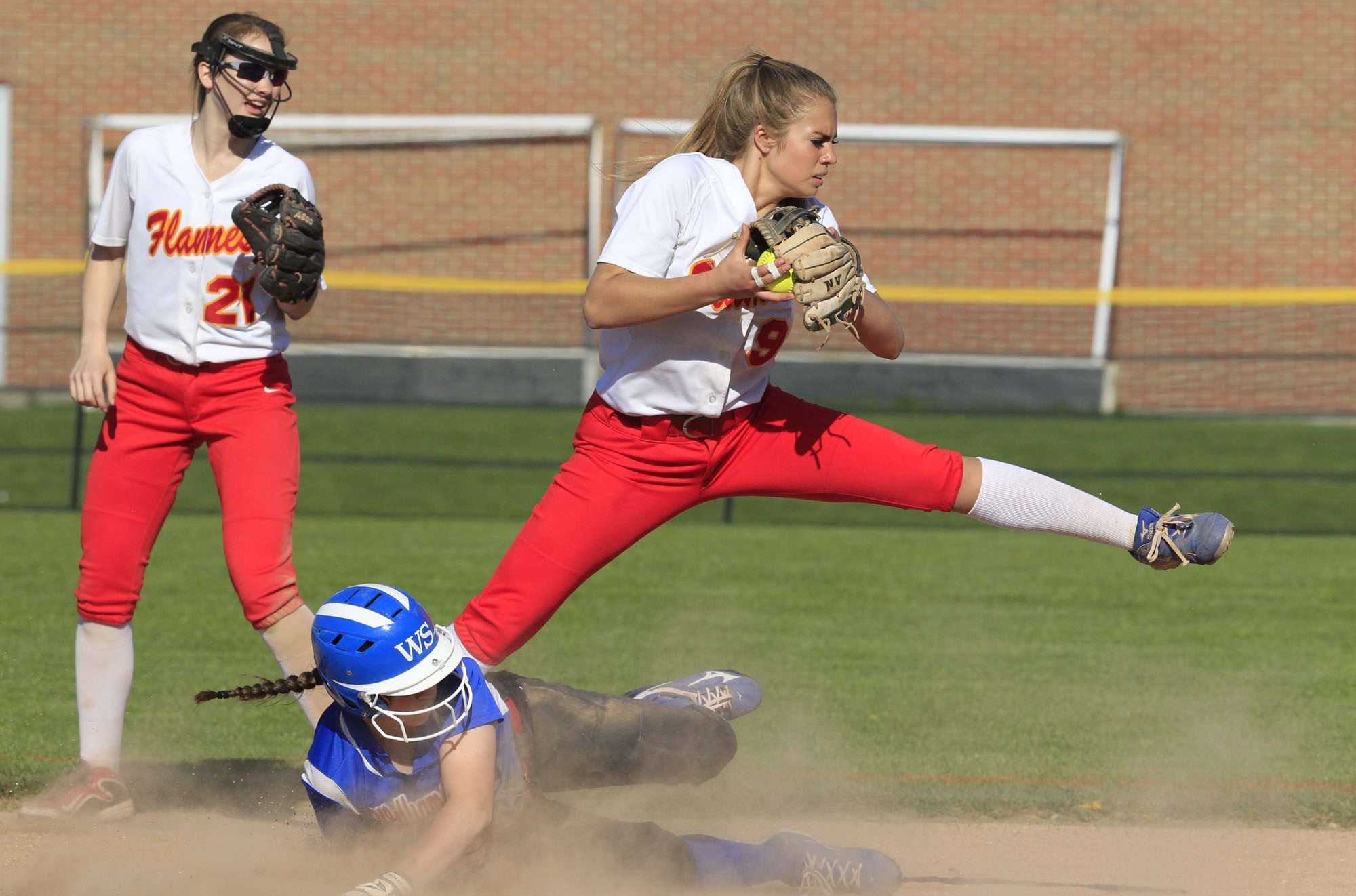 Williamsville South's Leah Czerwinski is forced out at second base by Williamsville East's Christy Mack during seventh inning action at Williamsville East high school  on Monday, May 9, 2016. (Harry Scull Jr./Buffalo News)