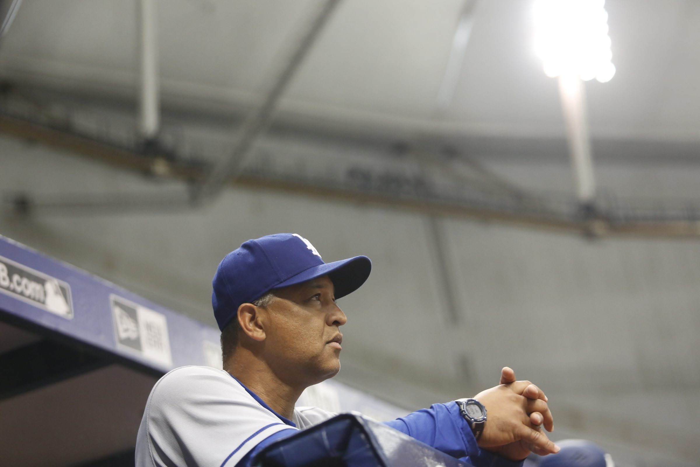 ST. PETERSBURG, FL - MAY 3:  Manager Dave Roberts #30 of the Los Angeles Dodgers looks on from the dugout during the first inning of a game against the Tampa Bay Rays on May 3, 2016 at Tropicana Field in St. Petersburg, Florida. (Photo by Brian Blanco/Getty Images)
