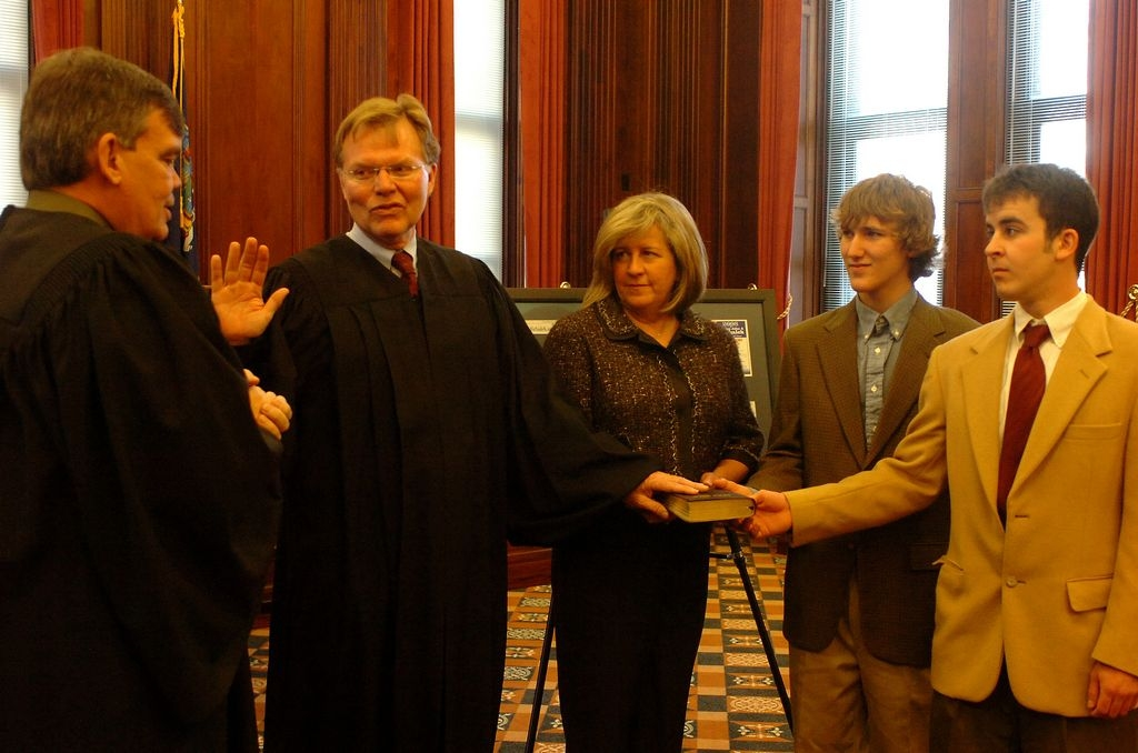State Supreme Court Justice John A. Michalek takes the oath of office in the ceremonial courtroom at County Hall in 2009. Present for the ceremony are Michalek's wife, Patricia, and sons Colin and John Conor. (News file photo)