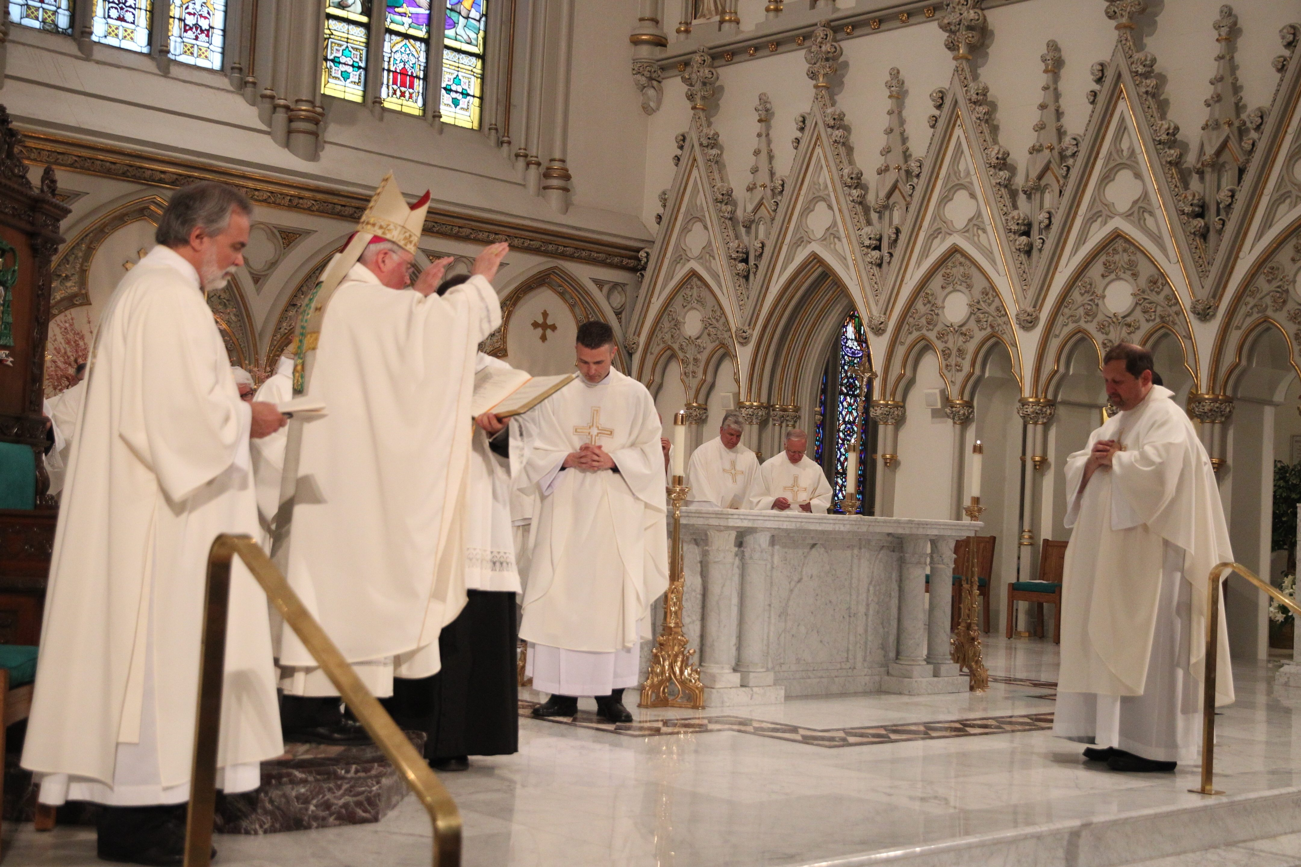 Michael K. Brown was ordained a priest by Bishop Richard J. Malone at St. Joseph Cathedral in Buffalo on Saturday.  (John Hickey/Buffalo News)