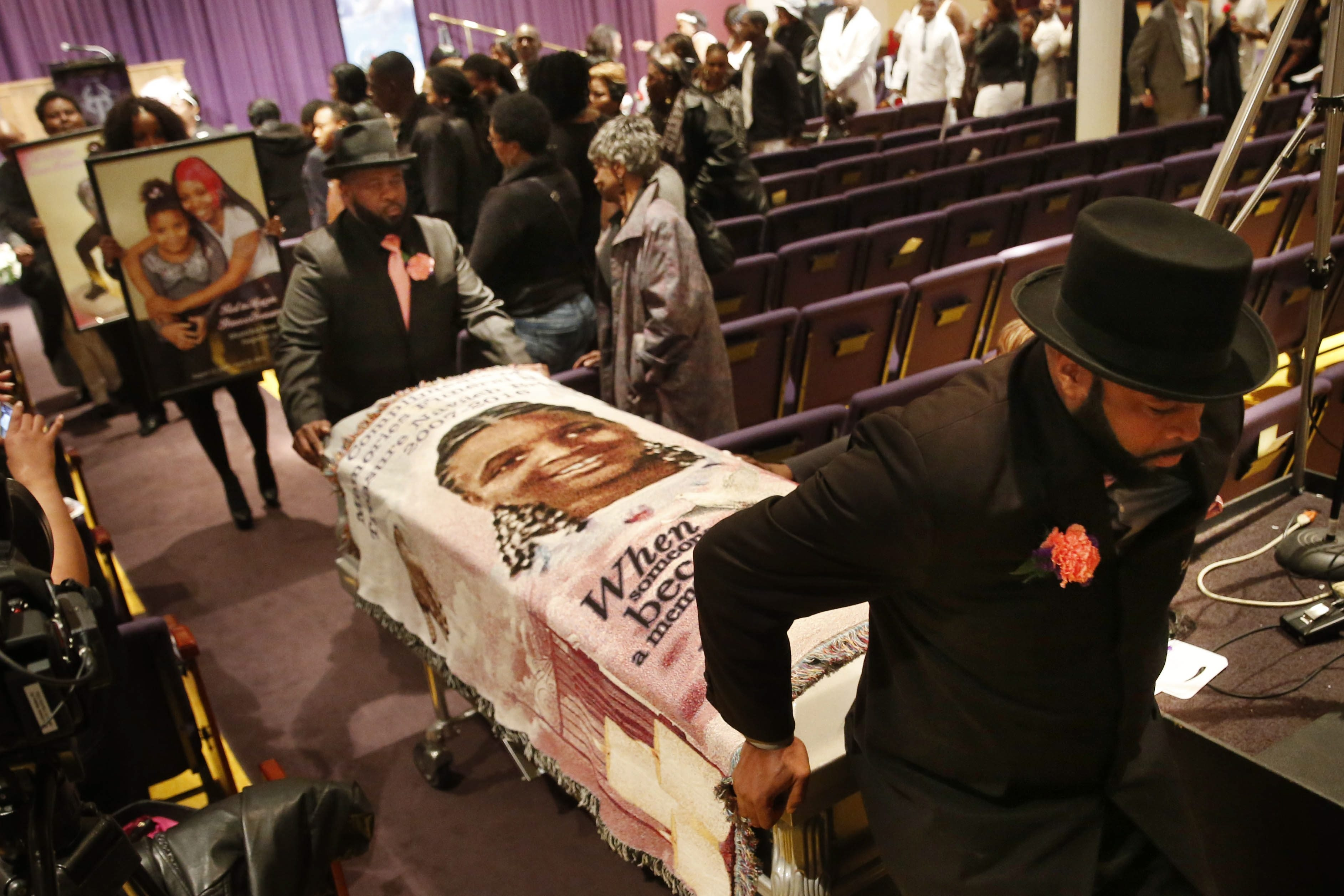 Pallbearers carry the casket of 8-year-old Treasure Brighon, who died after battling injuries she suffered in a deadly house fire in February, during her funeral at True Bethel Baptist Church on Monday.