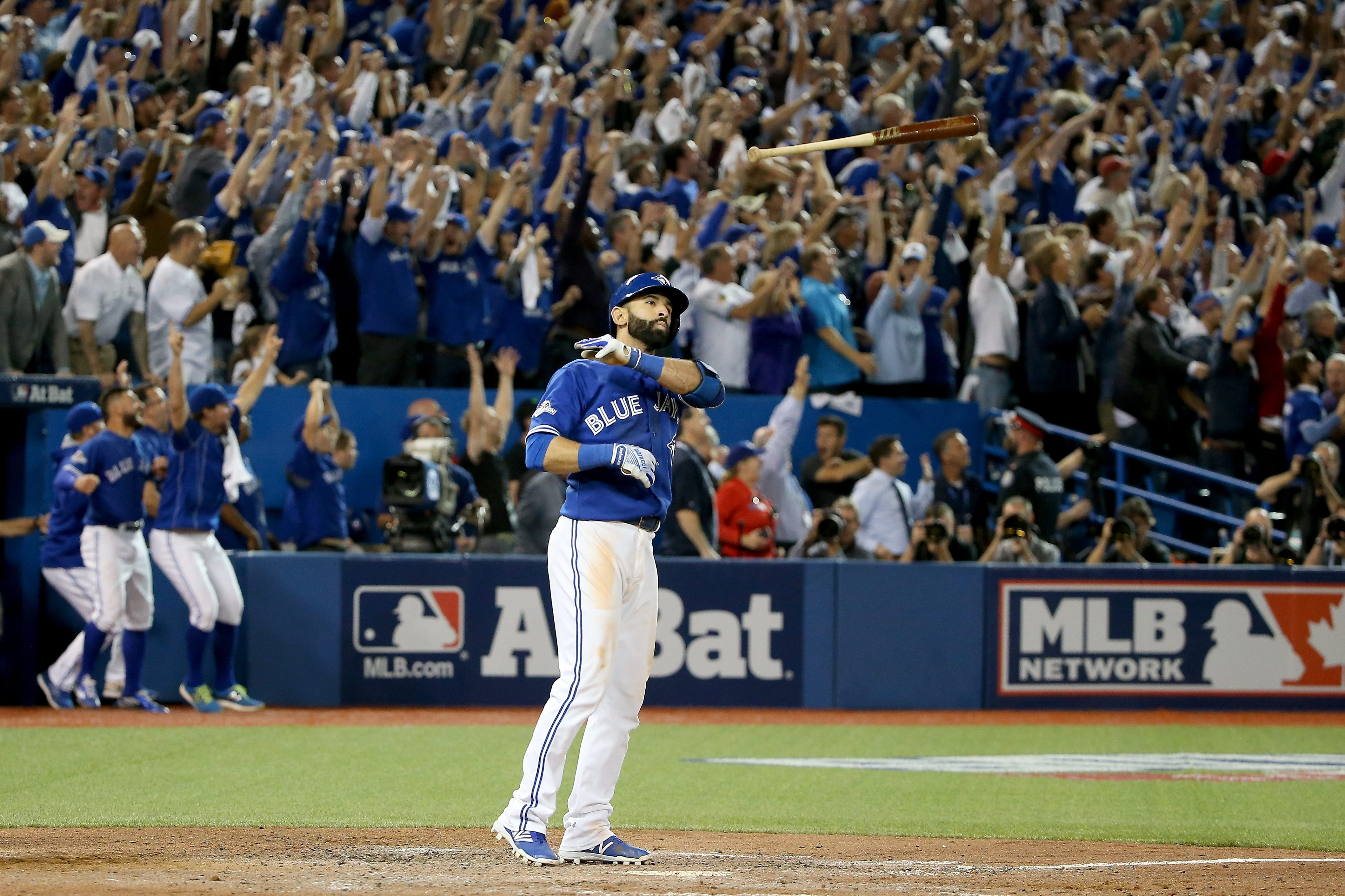 Jose Bautista of the Toronto Blue Jays with his now-famous bat flip after he hit a three-run home run in the seventh inning against the Texas Rangers in Game Five of the 2015 American League Division Series (Getty Images).