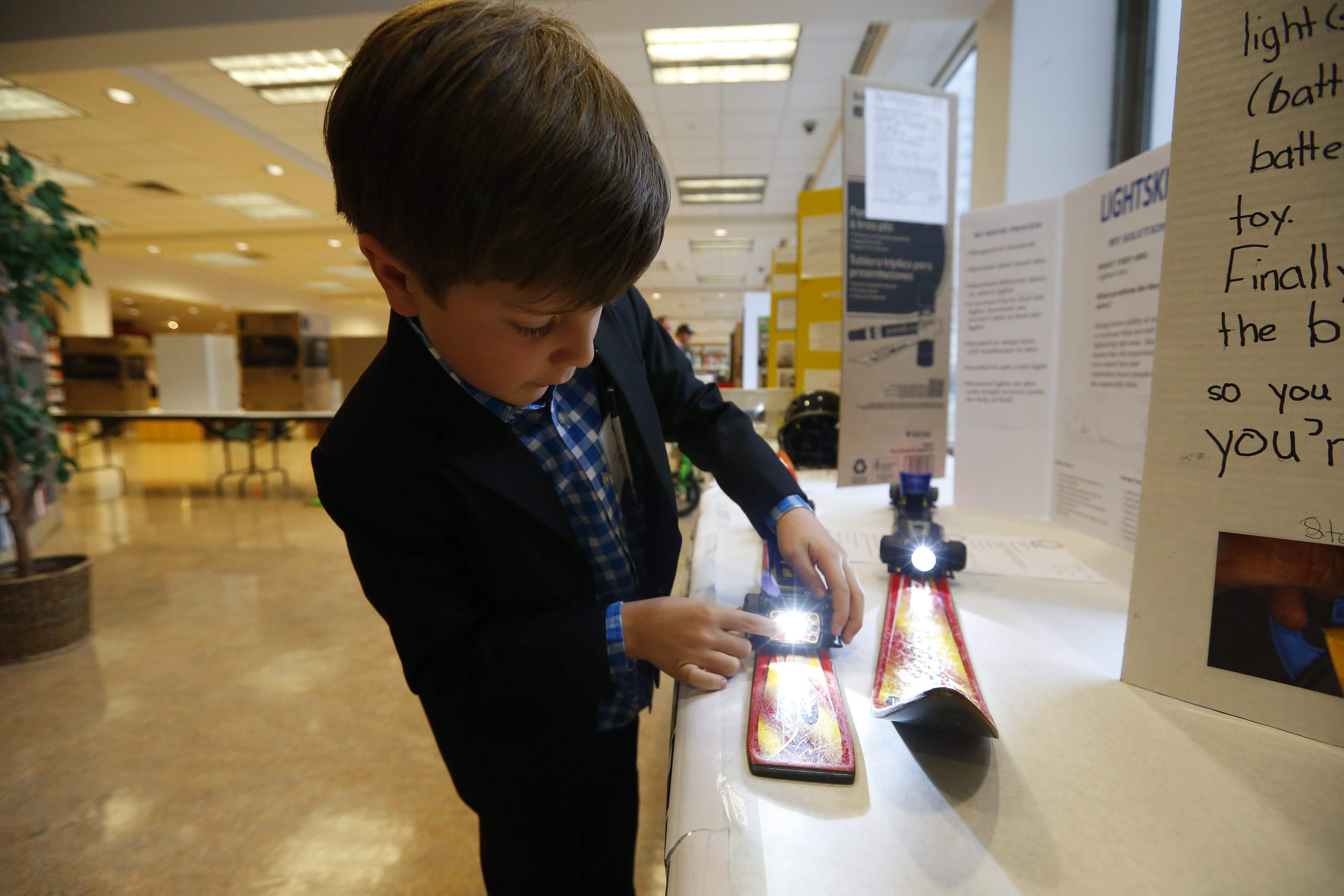 Matthew Murad, a second-grader from Olmsted School 64, presents his invention, Lightskis, during the 14th annual WNY Invention Convention. The competition was held on Sunday, May 1st, at the Central Library in downtown Buffalo.