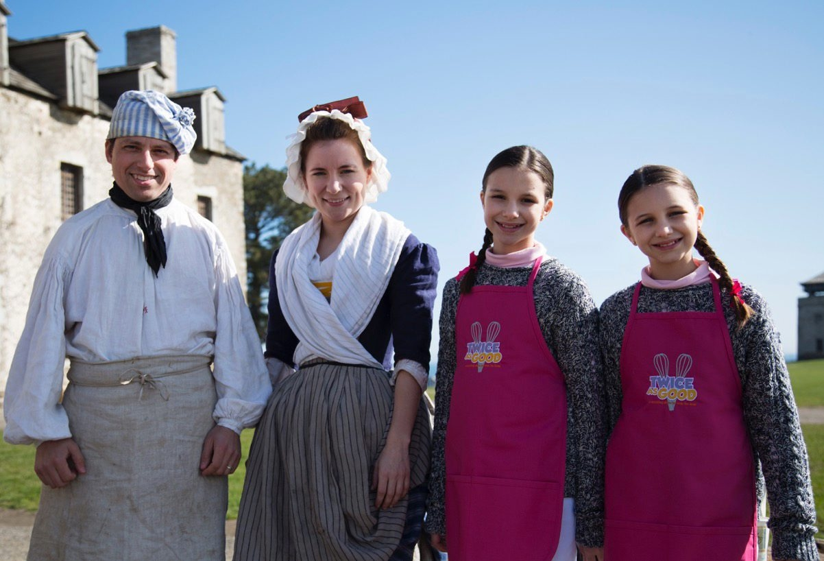 Brian McDonald, the fortþÄôs interpretive department assistant manager, along with interpreter Suzannah Emerson and hosts Hadley and Delaney Robertson.  PBS Kids Cooking Show Visits Old Fort Niagara for Niagara Weekend