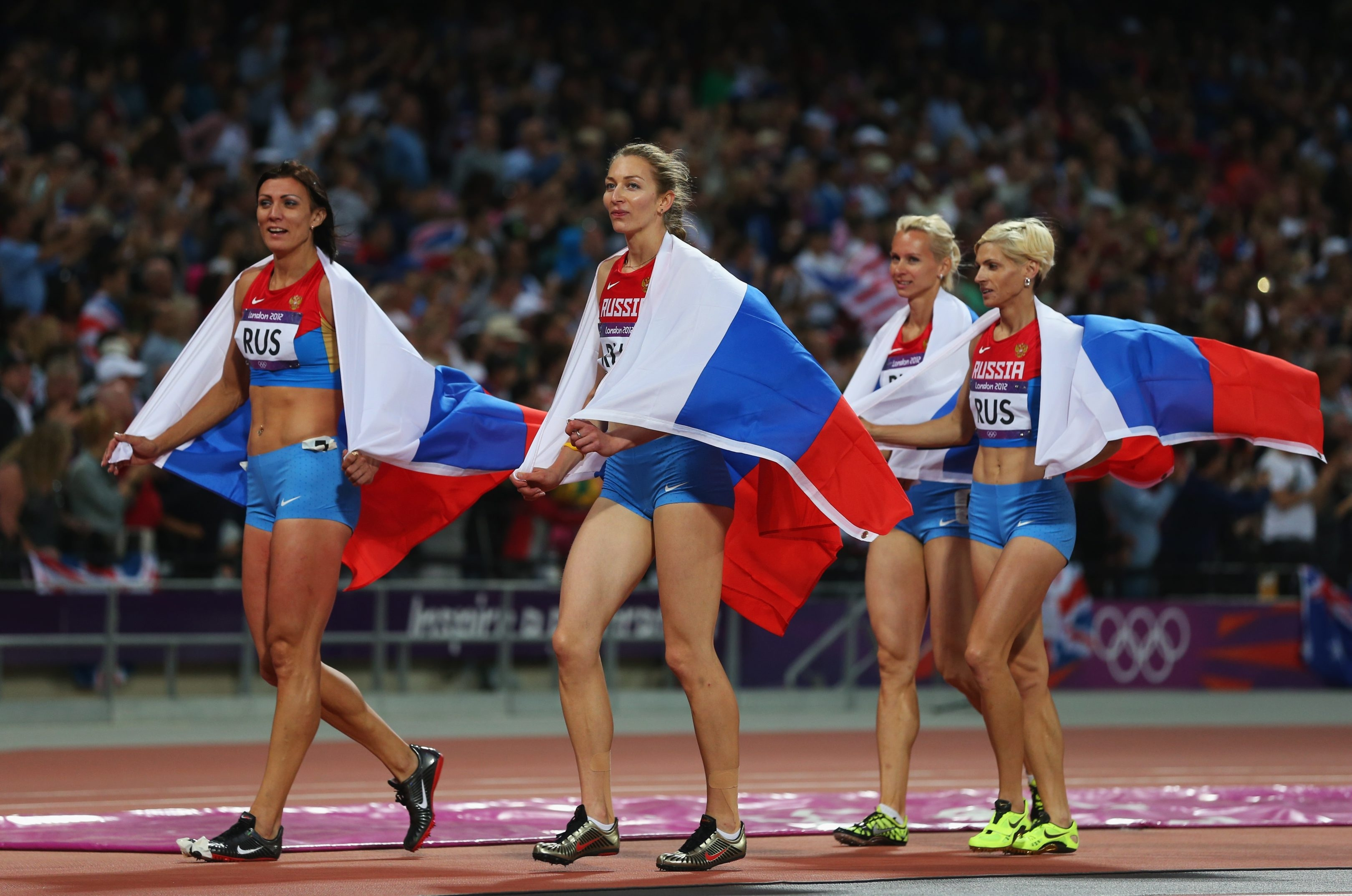 Natalya Antyukh, Tatyana Firova, Yulia Gushchina and Antonina Krivoshapka of Russia celebrate winning silver in the Women's 4x400 Relay Final at the London Olympics.
