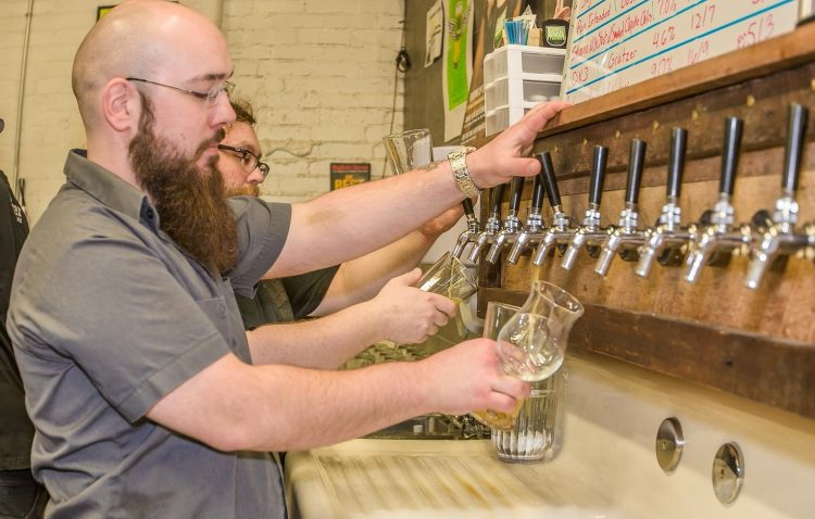 Beer is poured from multiple taps at CBW's fourth anniversary party. (Don Nieman/Special to The News)