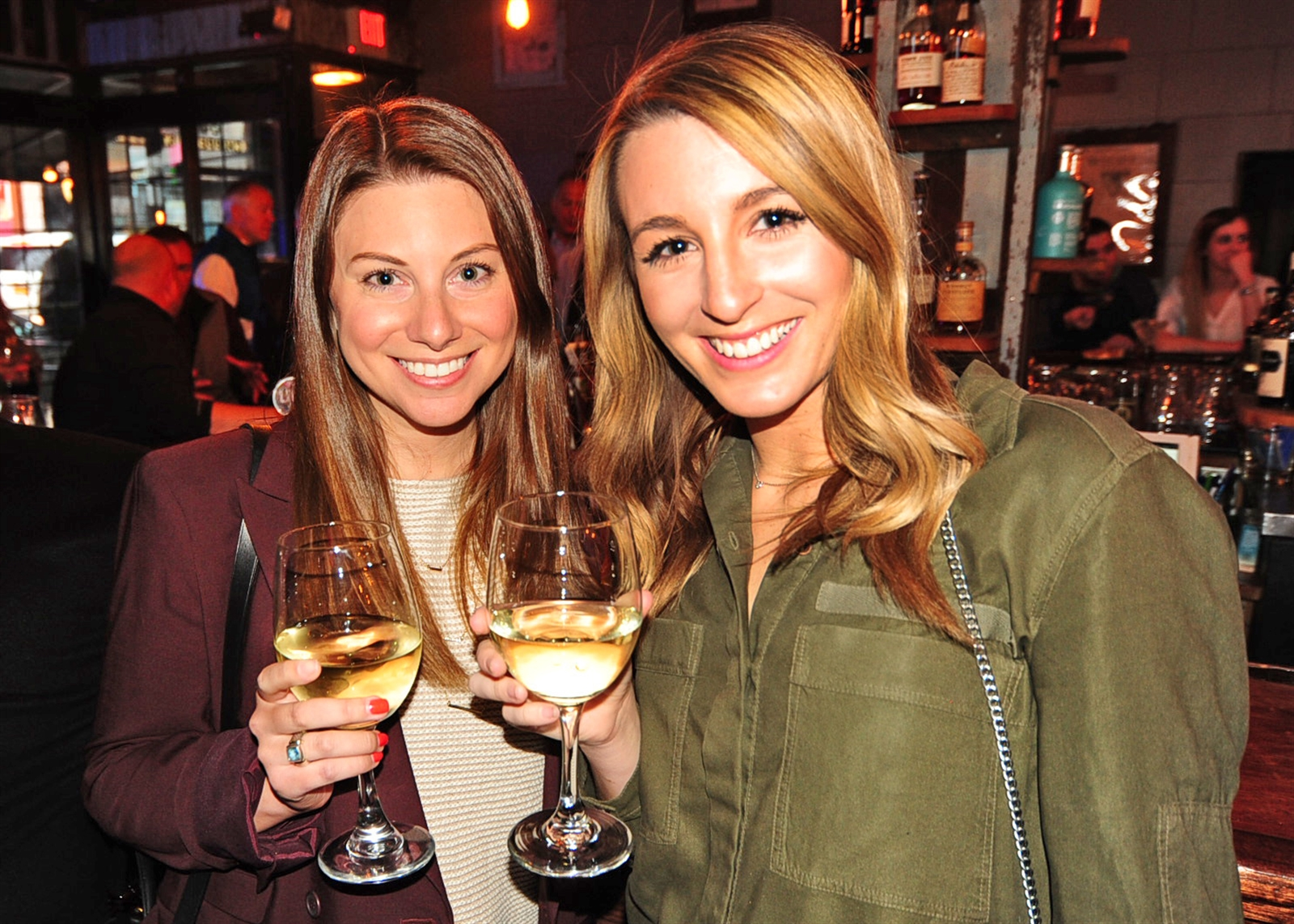 Patrons celebrate at Local Kitchen & Beer Bar's grand-opening party. (Dan Cappellazzo/Special to The News)