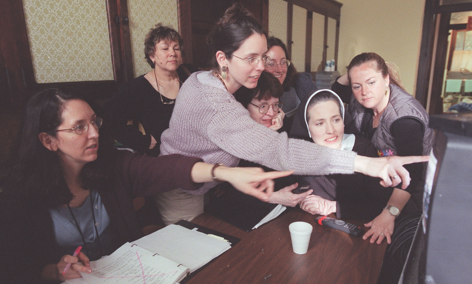 "The Burton sisters are Buffalo natives filmed filming ""Manna from Heaven"" in Buffalo. Here the family takes an excited look at a replay from a take in the last scene, in which Ursula appeared as Sister Theresa, during filming at Mt. St. Mary's Academy in Tonawanda on May 18, 2000. (Sharon Cantillon/Buffalo News file photo)"
