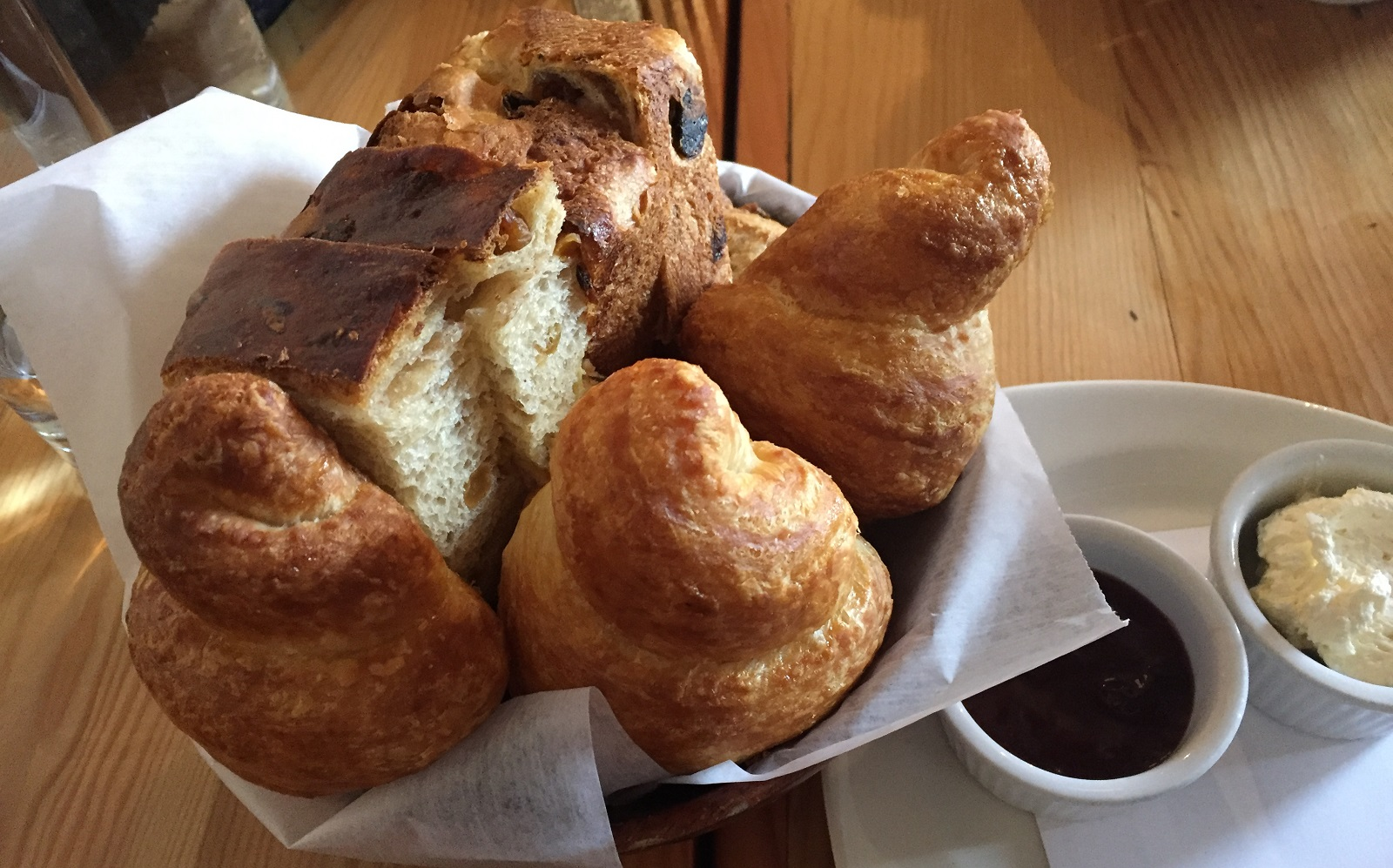 Brunch Game of Scones bread basket comes with cinnamon-raisin bread, croissants, housemade jam, and butter. (Caitlin Hartney/Special to The News)