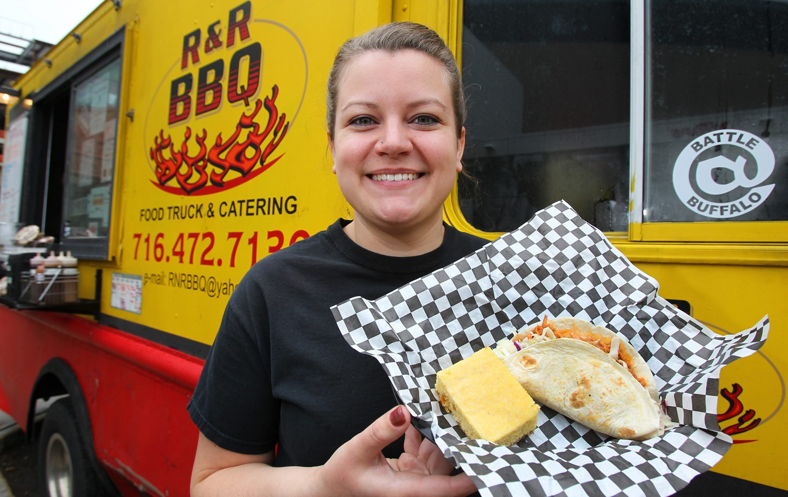 Owner Renee Allen presents a pulled pork taco from R&R BBQ Truck. (Mark Mulville/Buffalo News file photo)