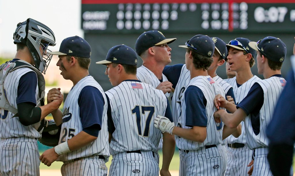 Canisius players congratulate each other on a victory in Game One of the Georgetown Cup finals Thursday at Coca-Cola Field. Pitcher Dan Dallas, center, threw a no-hitter. (Harry Scull/Buffalo News)