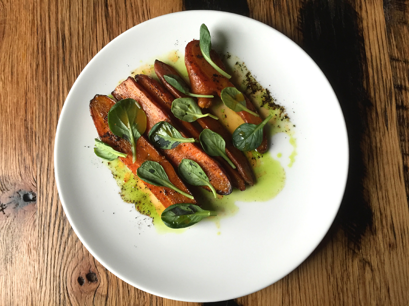 Chicory roasted carrots with chicory vinegar, carrot juice, tarragon oil, and tatsoi greens is one of Toutant chef de cuisine Joseph Fenush's inspired vegetable dishes. (Christa Glennie Seychew/Special to The News)