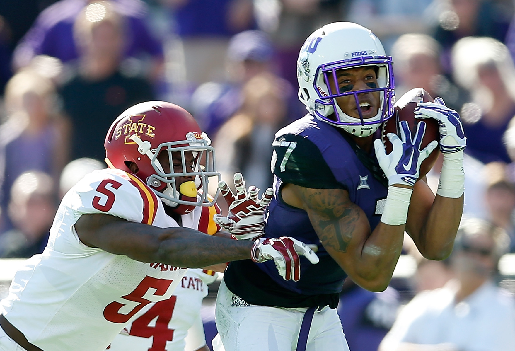 Wide receiver Kolby Listenbee, No. of the TCU Horned Frogs, catches a 49-yard reception of the Iowa State Cyclones during the second quarter of the Big 12 college football game in Decmeber 2014 in Fort Worth, Texas. (Getty Images)