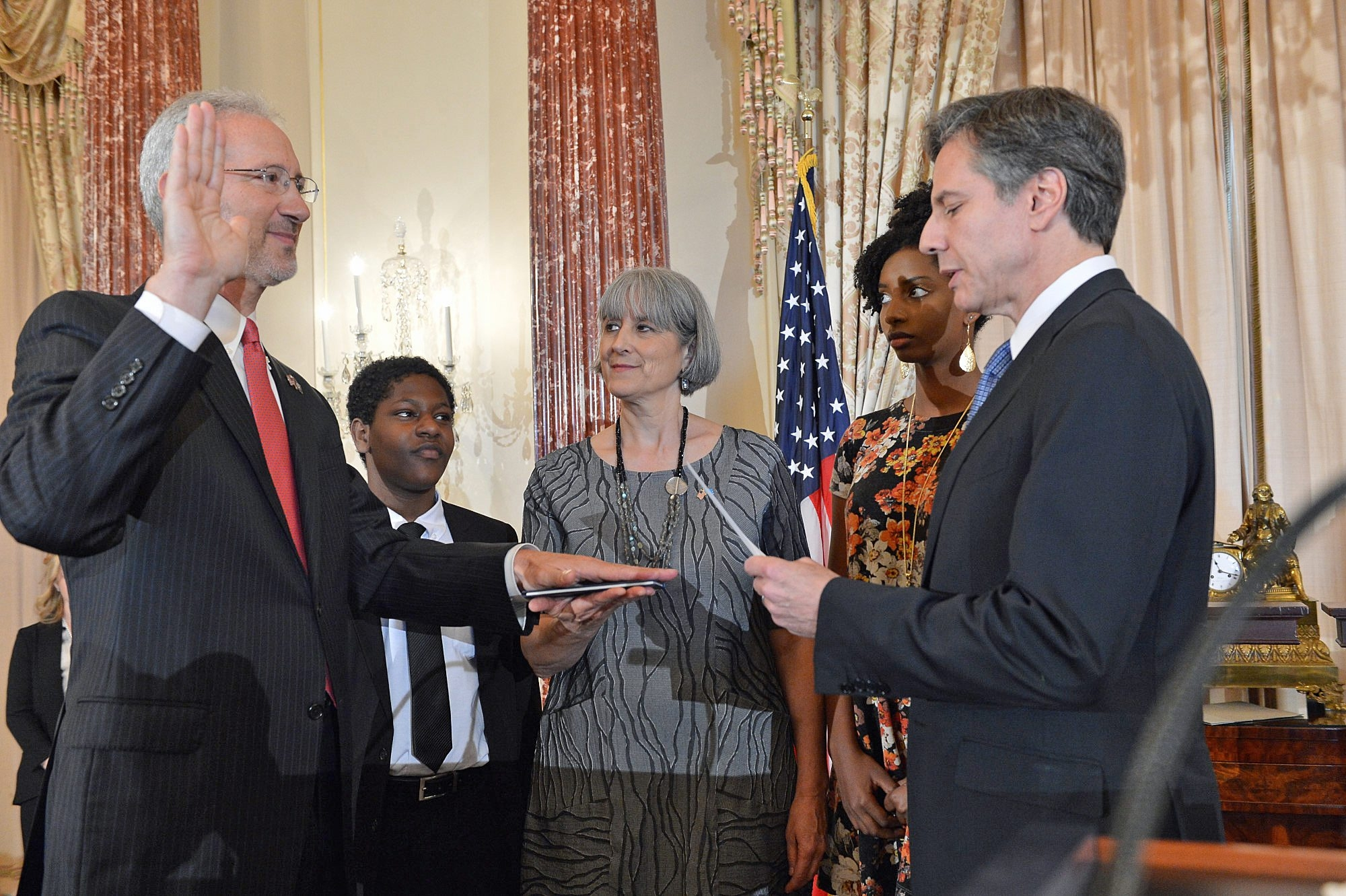 At State Department, WNY native Stephen M. Schwartz takes oath Monday as U.S. ambassador to Somalia from Deputy Secretary of State Antony J. Blinken. Joining in the ceremony are Schwartz's wife, Kristy Cook, and the couple's children, Jonas and Hannah.