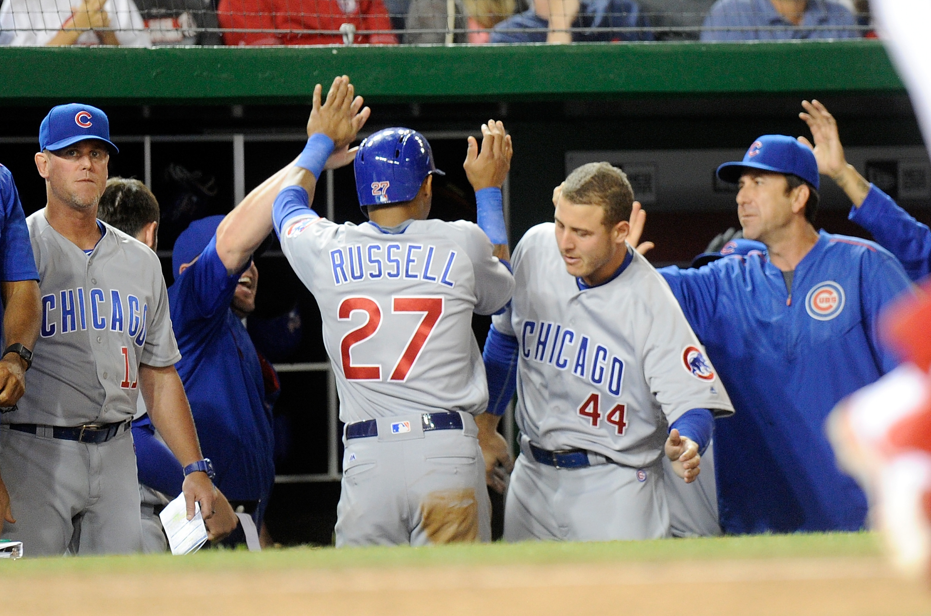 Addison Russell of the Chicago Cubs celebrates with teammates after scoring in the ninth inning against the Washington Nationals at Nationals Park on June 14. Chicago won the game 4-3.