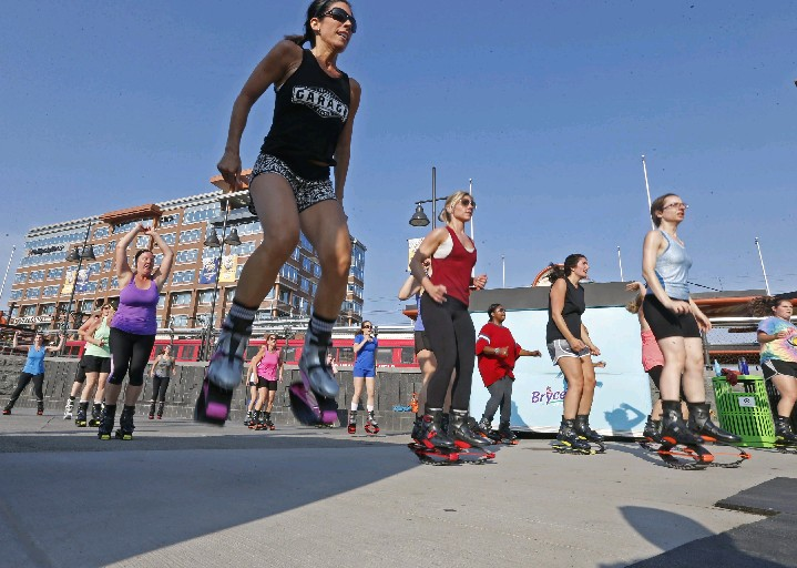 Kangoo Jumps at Canalside was among the new free outdoor fitness classes offered in the region this summer. Tonight is the last night for Canalside fitness classes this summer season. (Robert Kirkham/Buffalo News)