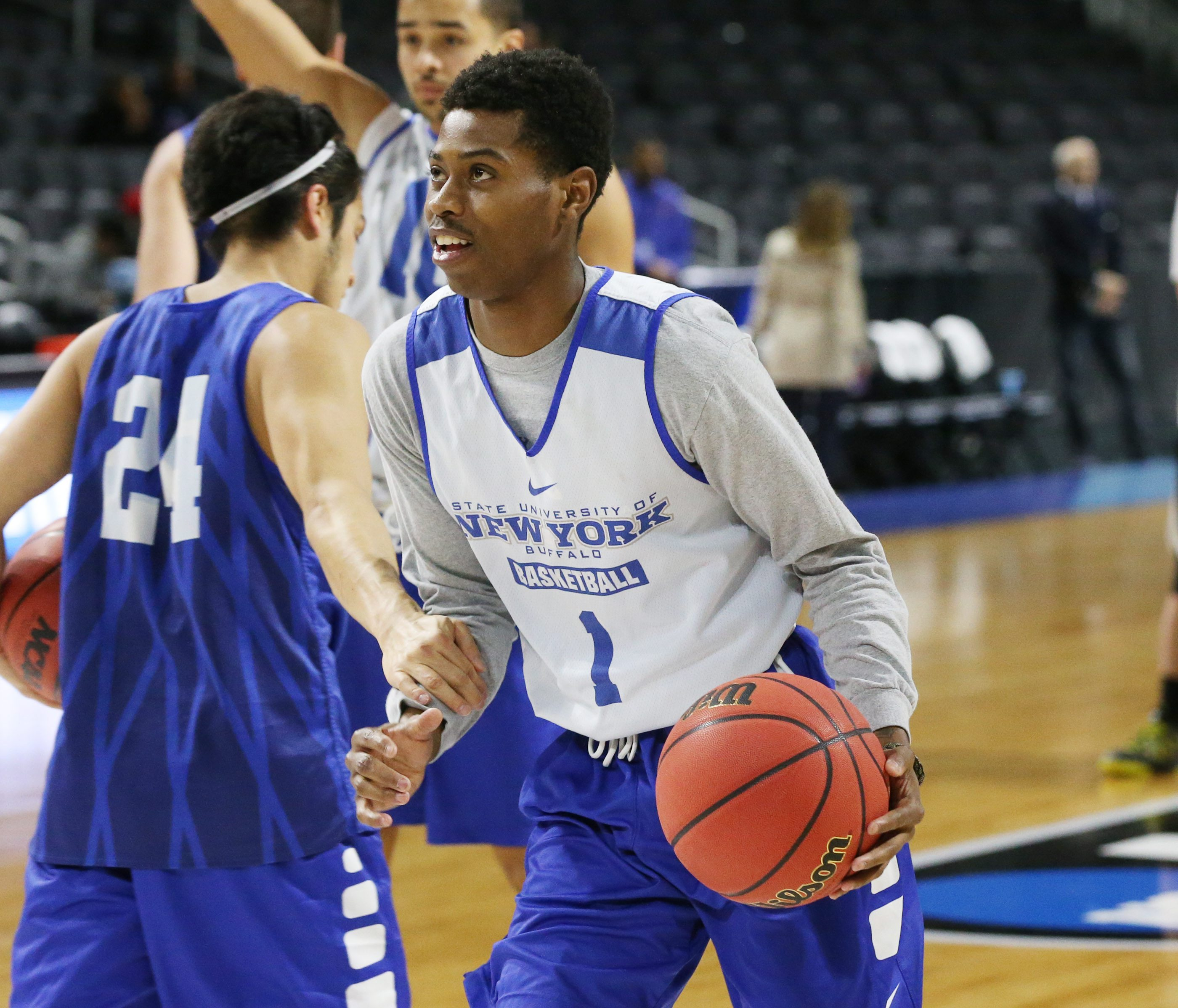 Lamonte Bearden (1) takes a shot during UB's NCAA Tournament practice at Dunkin' Donuts Center in Providence in March.  (James P. McCoy/ Buffalo News)