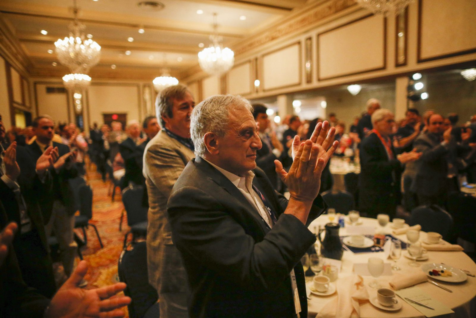 GOP Delegate Carl Paladino of Buffalo applauds during the New York delegation breakfast at the Renaissance Hotel in Cleveland on July 18. (Derek Gee/Buffalo News)