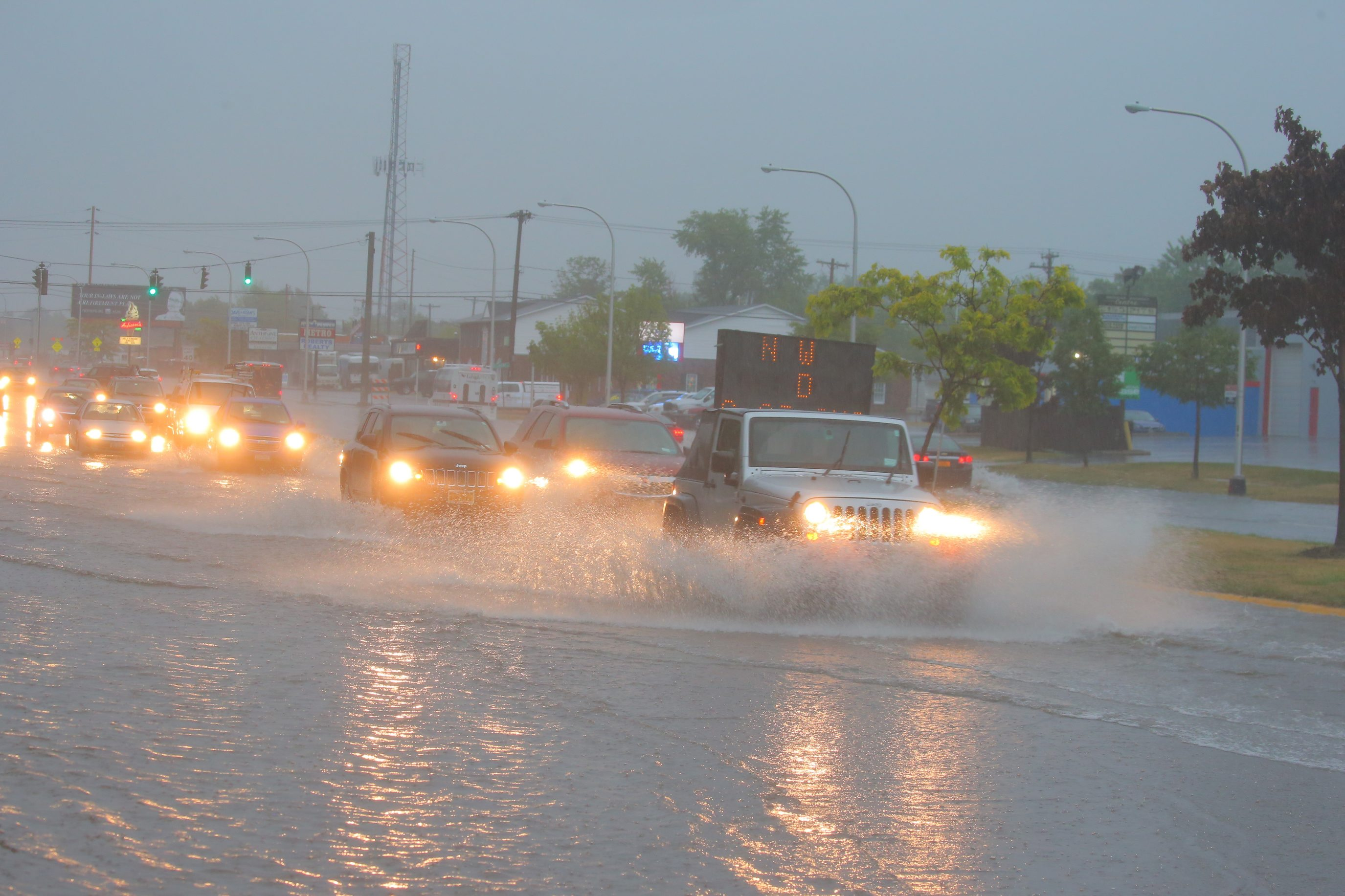 Traffic on wet roads with pooling water Sheridan Drive in Town of Tonawanda, N.Y.,on Monday July 25, 2016, after thunderstorms swept through the area this morning.  (John Hickey/Buffalo News)