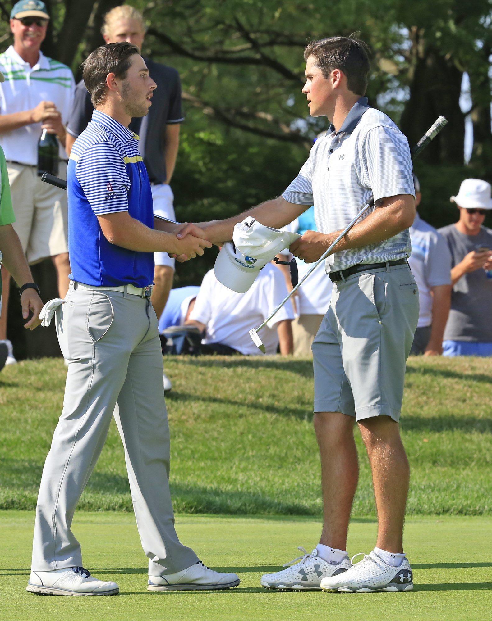 Gavin Hall congratulates Harrison Endycott (Harry Scull Jr./Buffalo News)